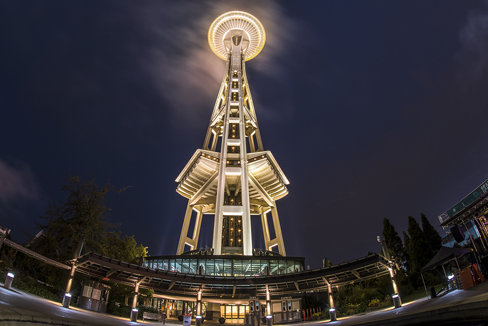 One of a Kind. - The Space Needle is an observation tower in Seattle, Washington, a landmark of the Pacific Northwest and an icon of Seattle. It was built in the Seattle Center for the 1962 World's Fair, which drew over 2.3 million visitors. Nearly 20,000 people a day used its elevators. It unveiled its latest addition: the world's first and only revolving glass floor, known as