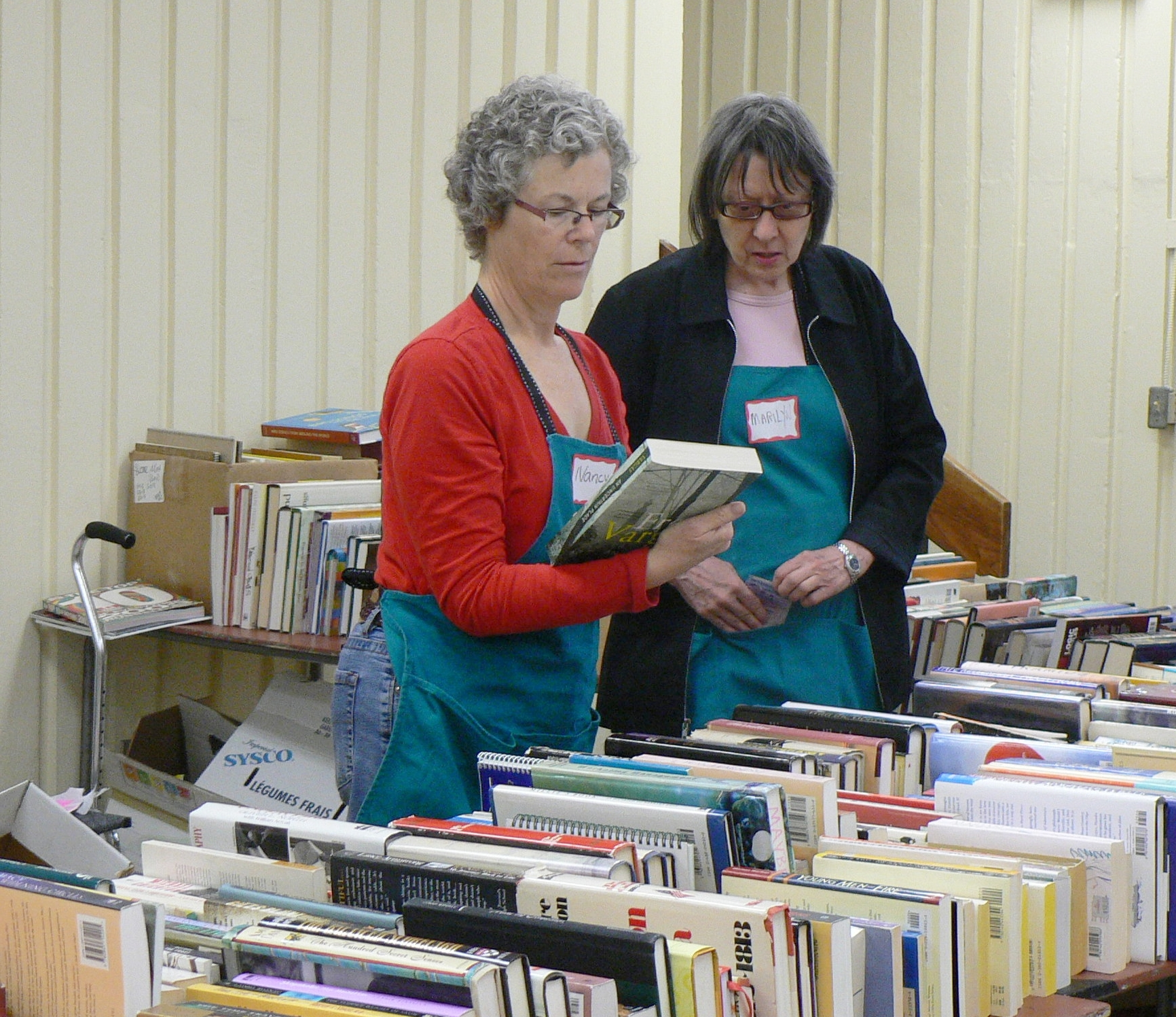 Nancy and Marilyn with books.JPG