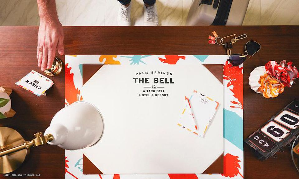 https___blogs-images.forbes.com_micheleherrmann_files_2019_05_The-Bell_-A-Taco-Bell-Hotel-and-Resort-Front-Desk.jpg