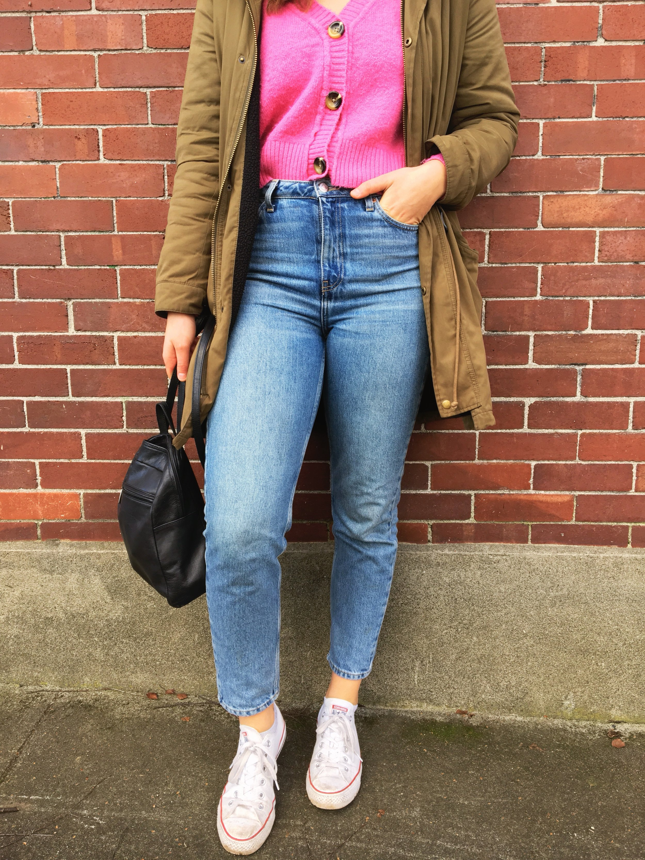 woman standing against a brick wall wearing green army jacket pink topshop cardigan and mom jeans Canadian lifestyle blogger fashion blogger Victoria blogger