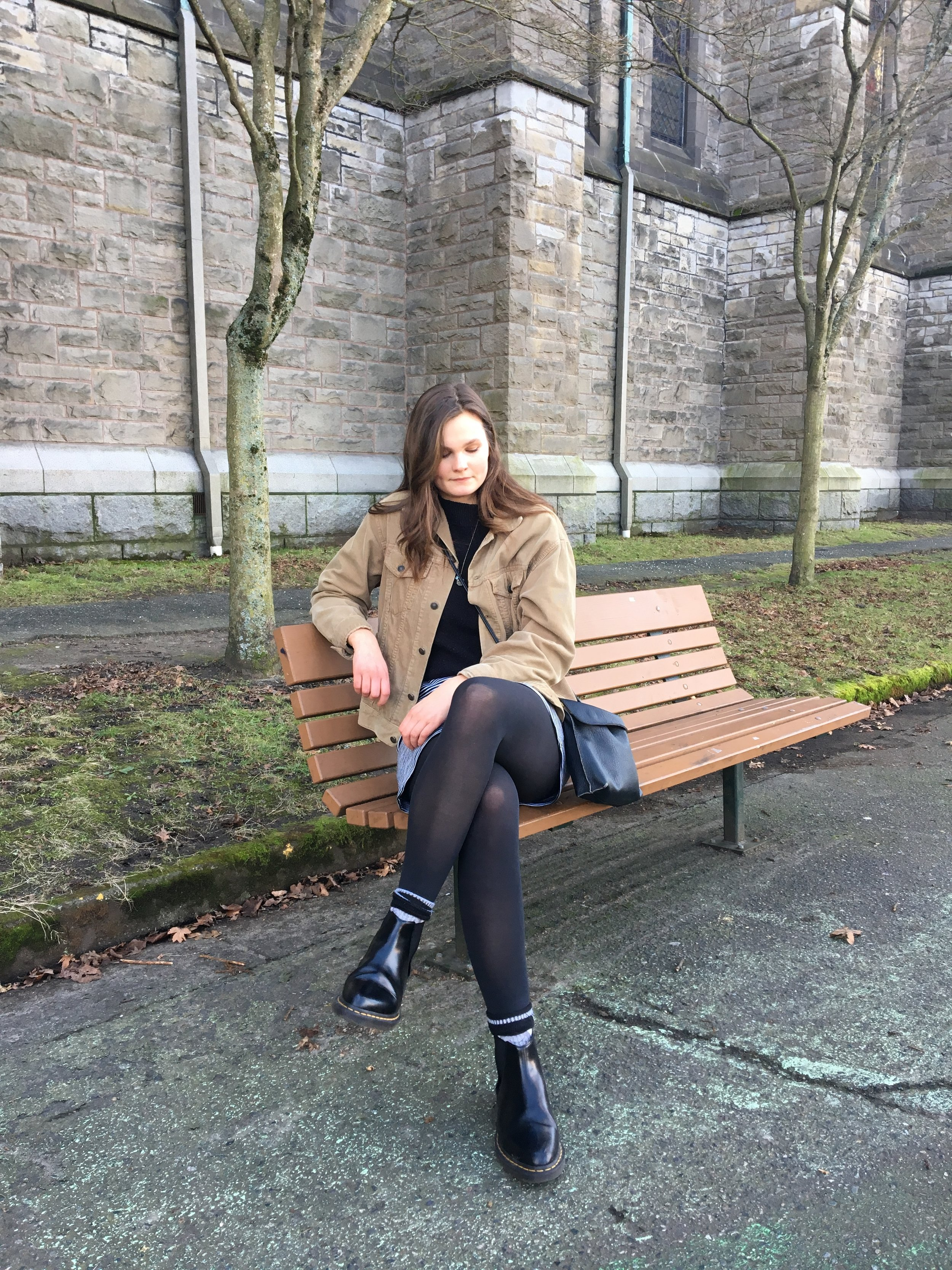 woman sitting on a bench wearing tights and doc marten boots lifestyle blog Canadian blogger writing blog west coast blogger