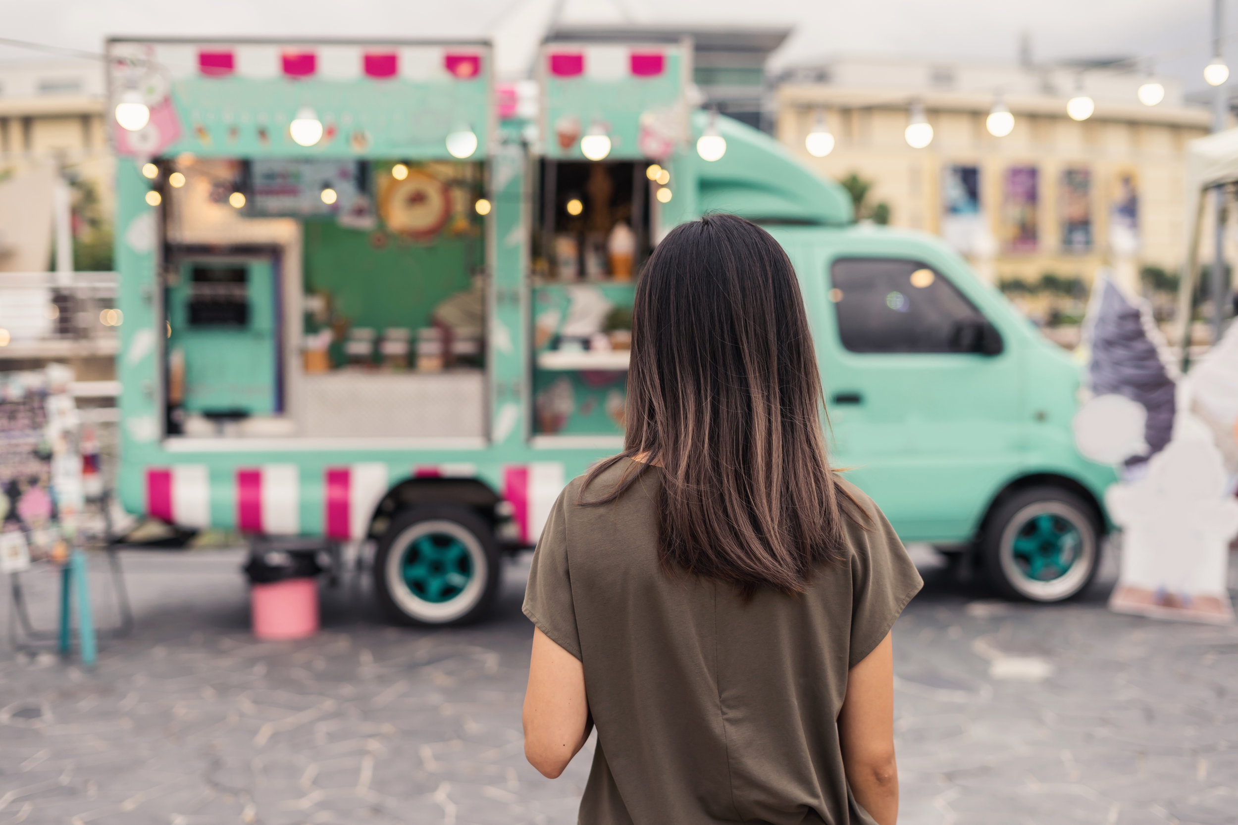 Woman standing in front of Food Truck