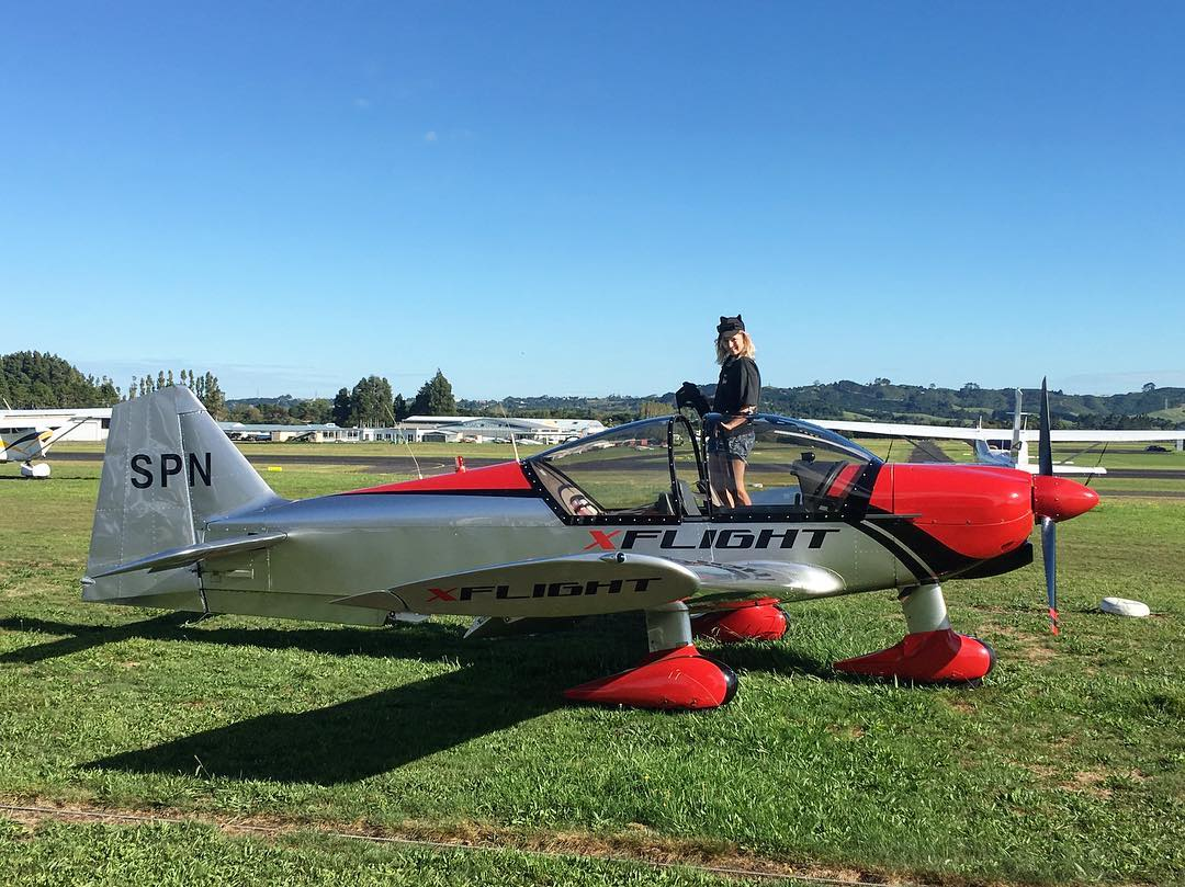 Kerrin Osborne from Kaus Hats doing what she loves, flying a plane.