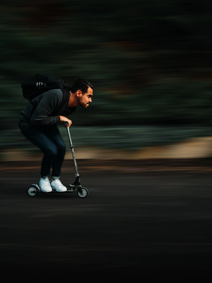 man on scooter.png
