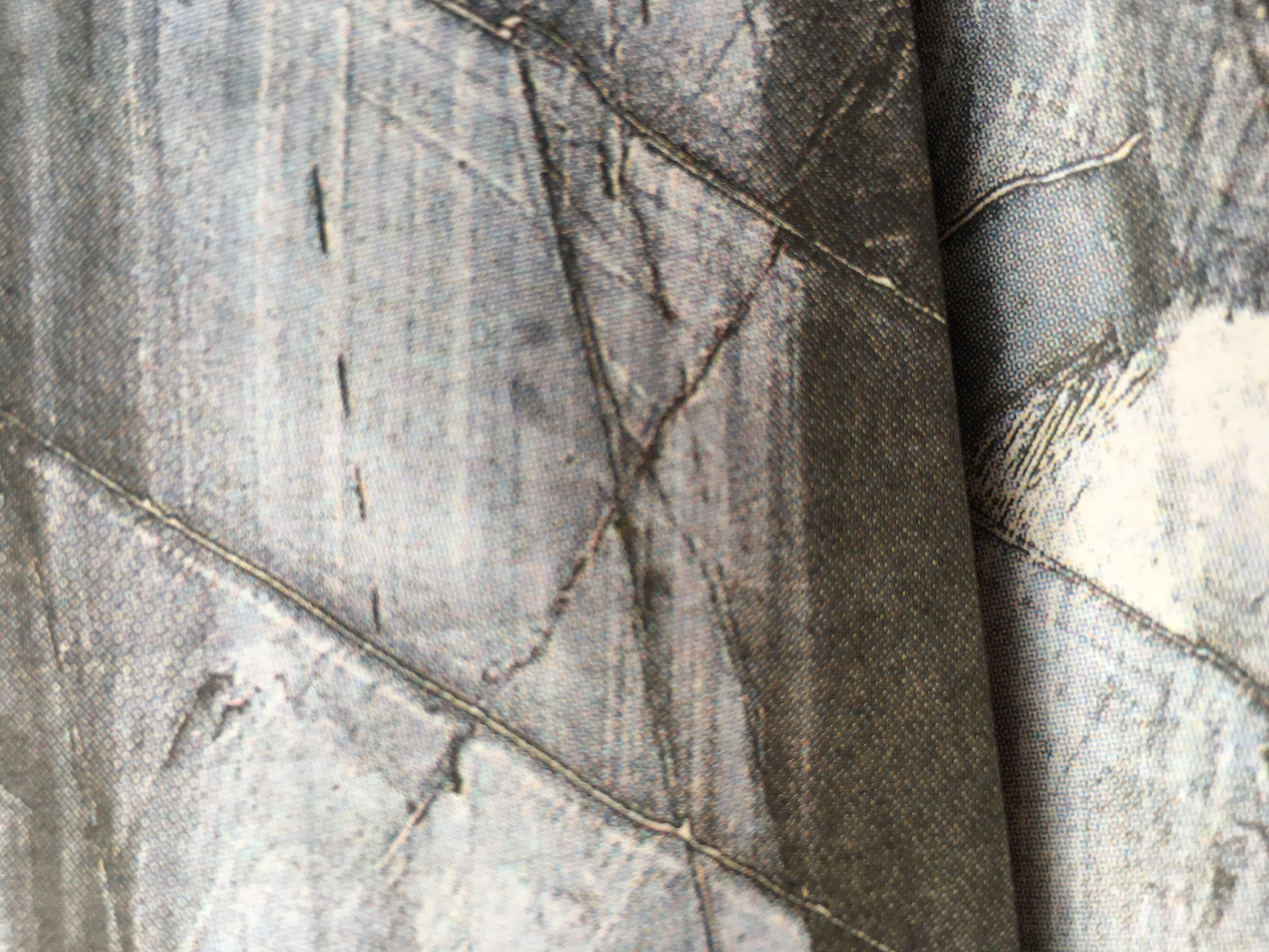 PIxelated view of cut marble…