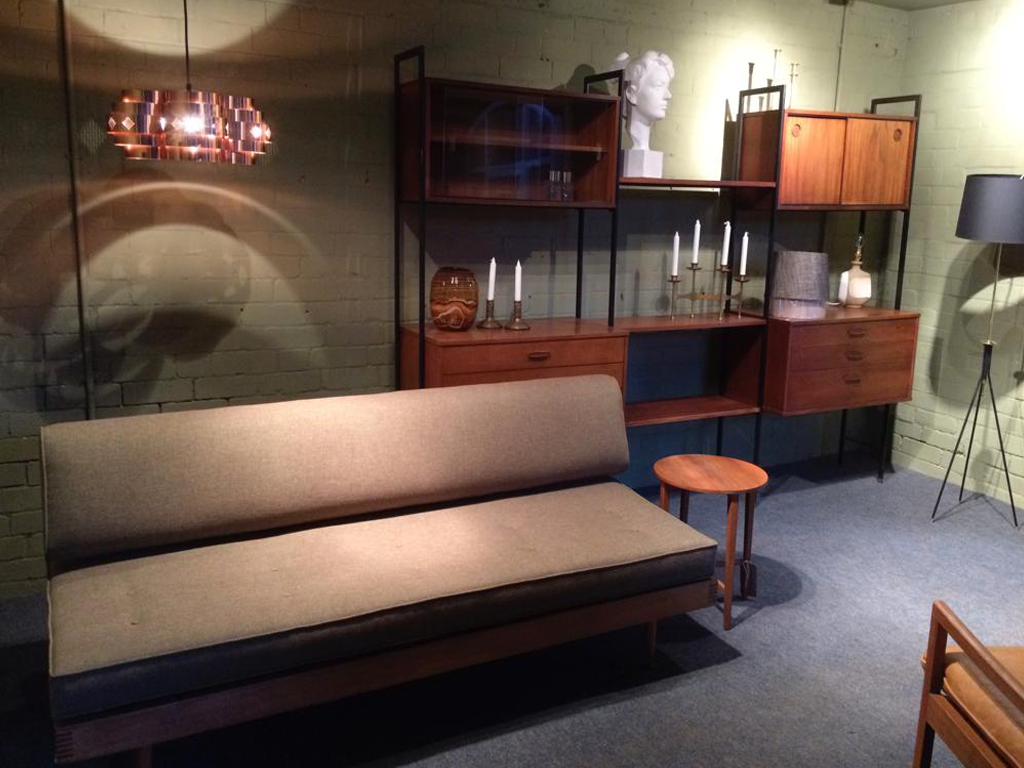 Restored wool daybed with copper pendant light.