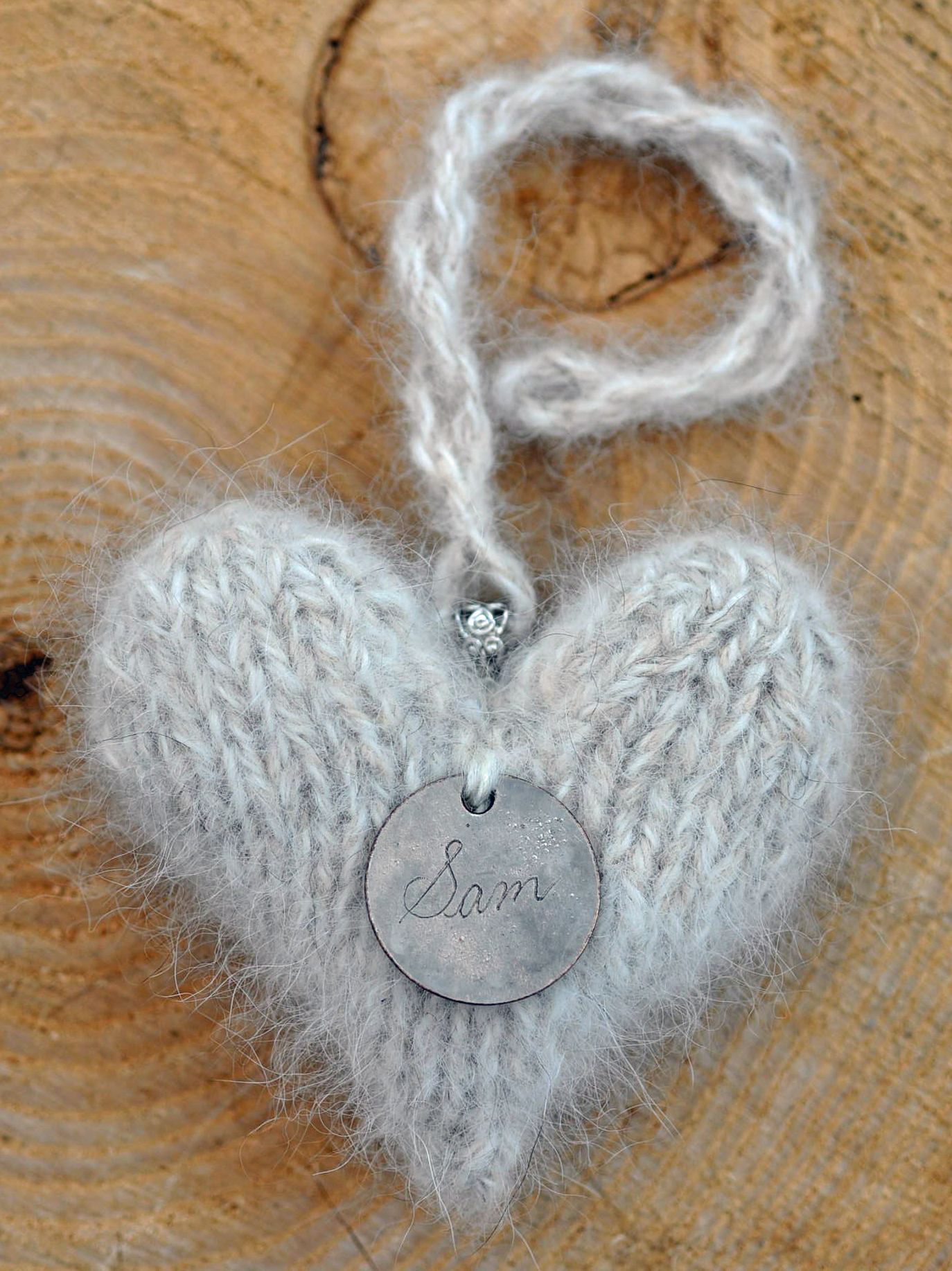 Keepsake made from Pyrenean dog hair with tag attached.jpg