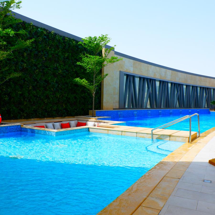 alrayyan-hotel-curio-hilton-pool.jpg