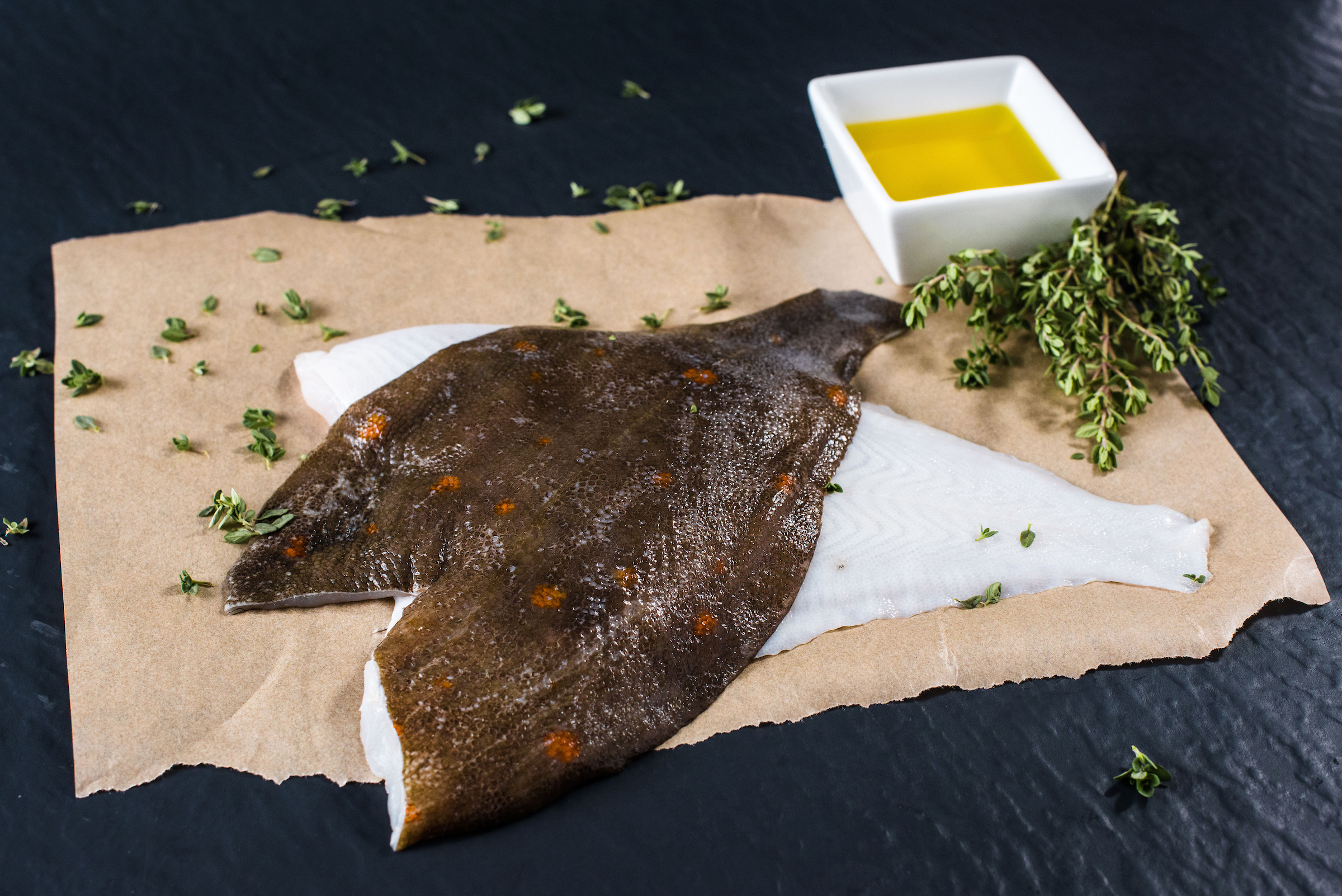 How to cook Plaice - Using scissors, cut the head, tail and fins off. Place the fish in tin foil with butter, lemon juice, salt and pepper. Then place in oven at 180 degrees for 15 or 20 minutes depending on size.