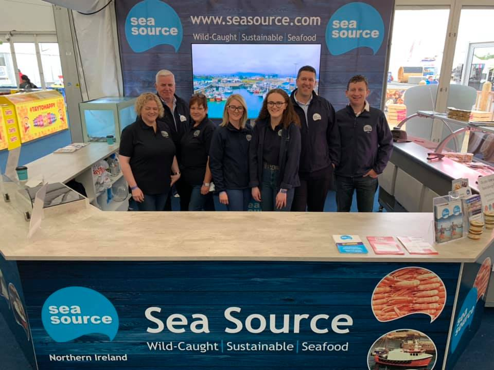 BALMORAL SHOW 2019   POSTED: 20/05/2019  This is the 5th year Sea Source has exhibited at the Balmoral Show. The show provides us with a platform to promote the best in Northern Ireland Seafood, sourced from Kilkeel, Ardglass and Portavogie.  The process starts at sea, where the fishermen catch World Class and sustainable seafood from the Irish Sea and adjacent waters. They are supported by Sea Source's dedicated team based in Kilkeel.  We wish to thank everyone who visited our stand at Balmoral 2019 and who support the Sea Source Seafood Shop in Kilkeel throughout the year.  A special thanks to the entire team who make everything Sea Source does possible. First and foremost our bosses - the local trawler owners and fishermen. The onshore teams in fish sales, the factories and in the office. To everyone who makes Balmoral work - thank you. All the staff enjoy the show and they ALL deserve credit for the effort put in - from preparing the seafood at home to cooking it, selling it and cleaning up at Balmoral!  We've had a lot of fun at Balmoral 2019 and we're already excited about the next events this year, as well as looking forward to Balmoral 2020!