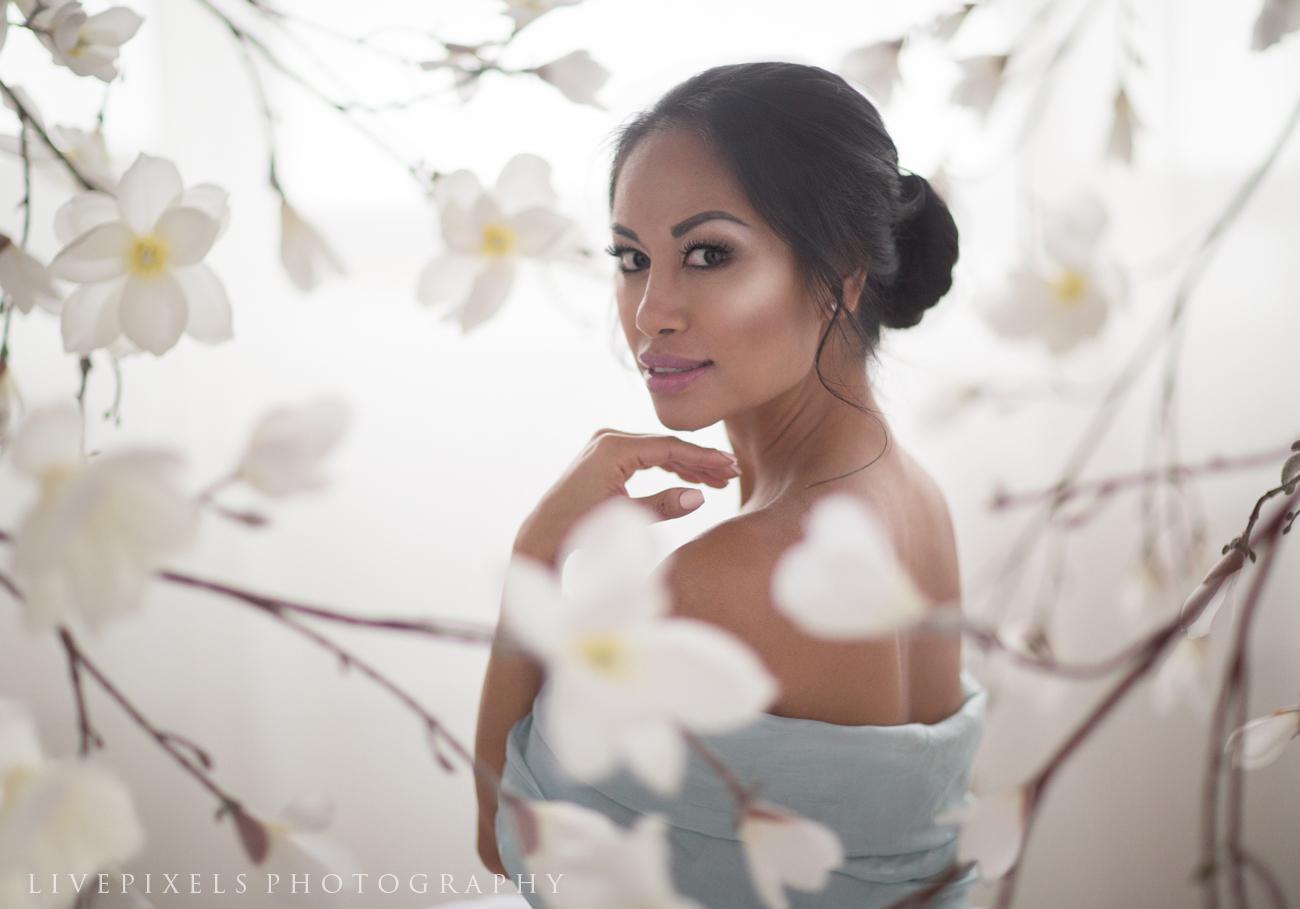 Studio portrait of a lady in magnolia blooms.jpg