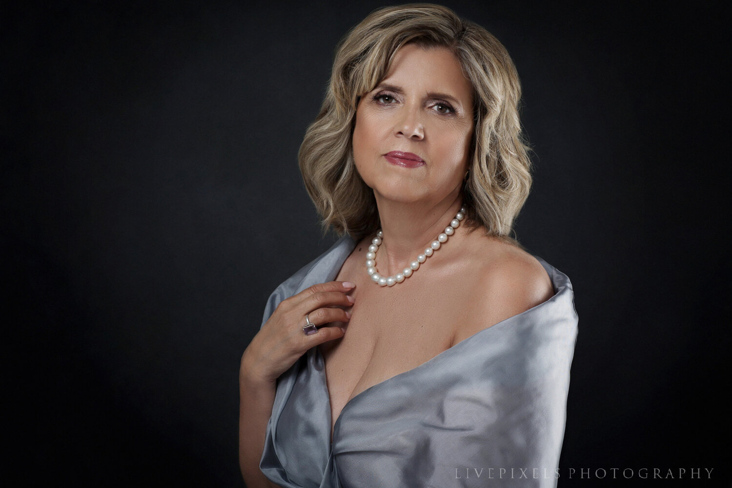 portrait of a woman with pearl necklace.jpg