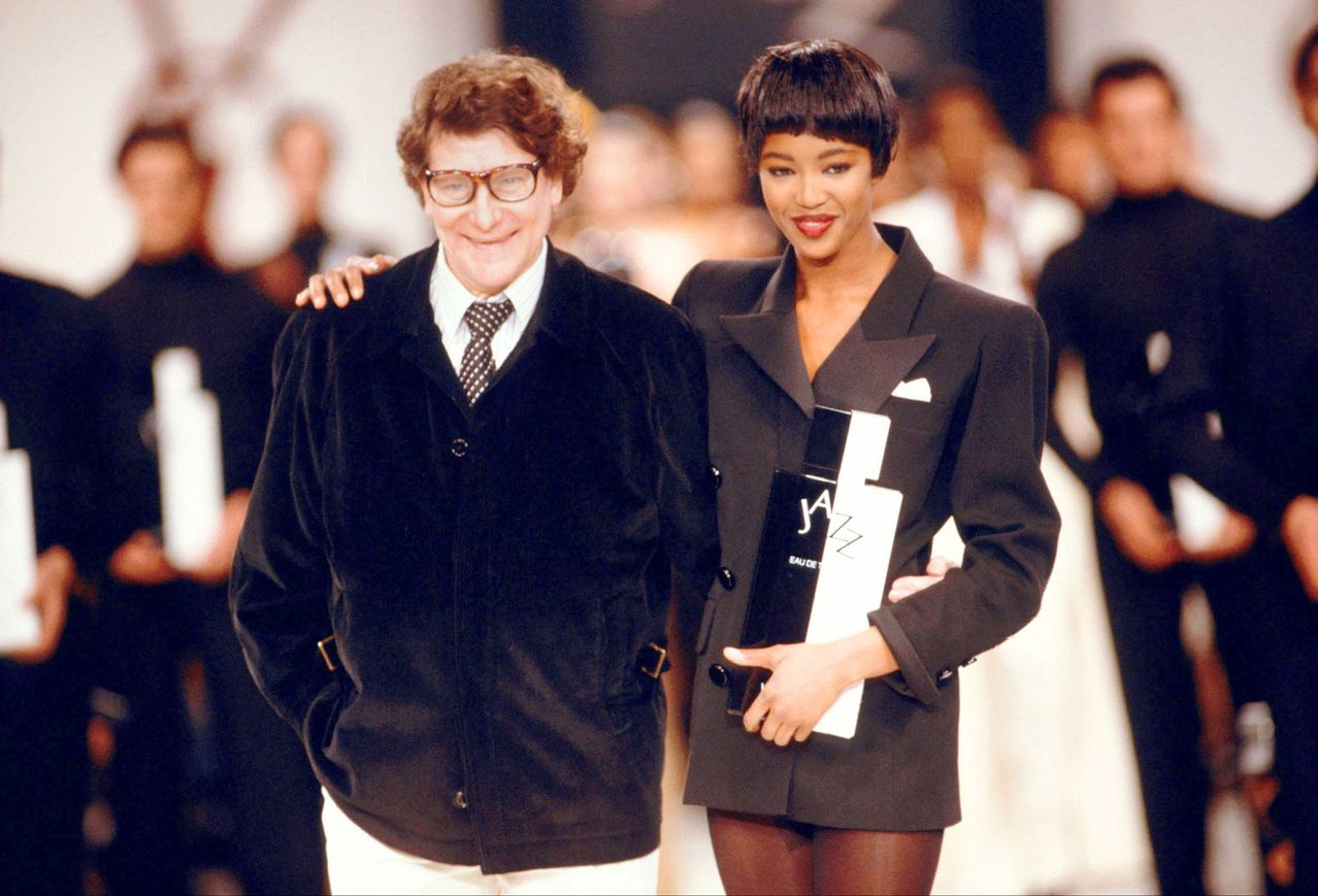 Yves St Laurent with Naomi Campbell at one of his fashion shows. Campbell credits YSL with getting her, her first cover which made her the first Black model to be on the cover of  French Vogue . Image source: unknown.