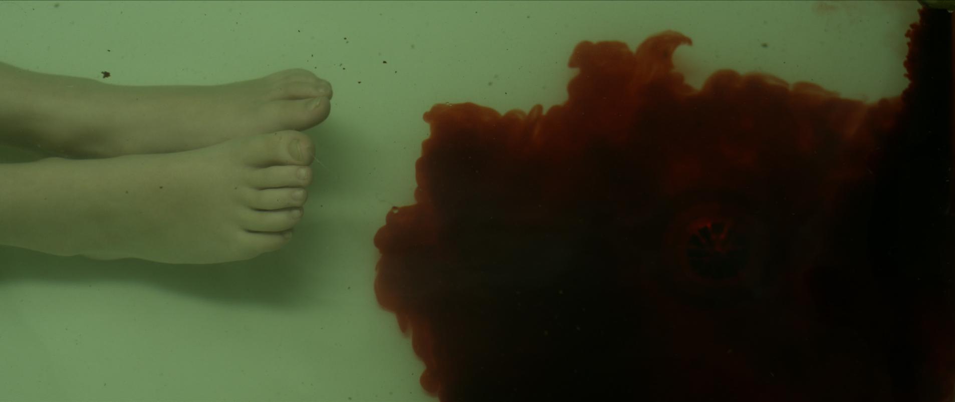 Blood spreading towards Coco's feet in bathtub water, supernatural.jpg