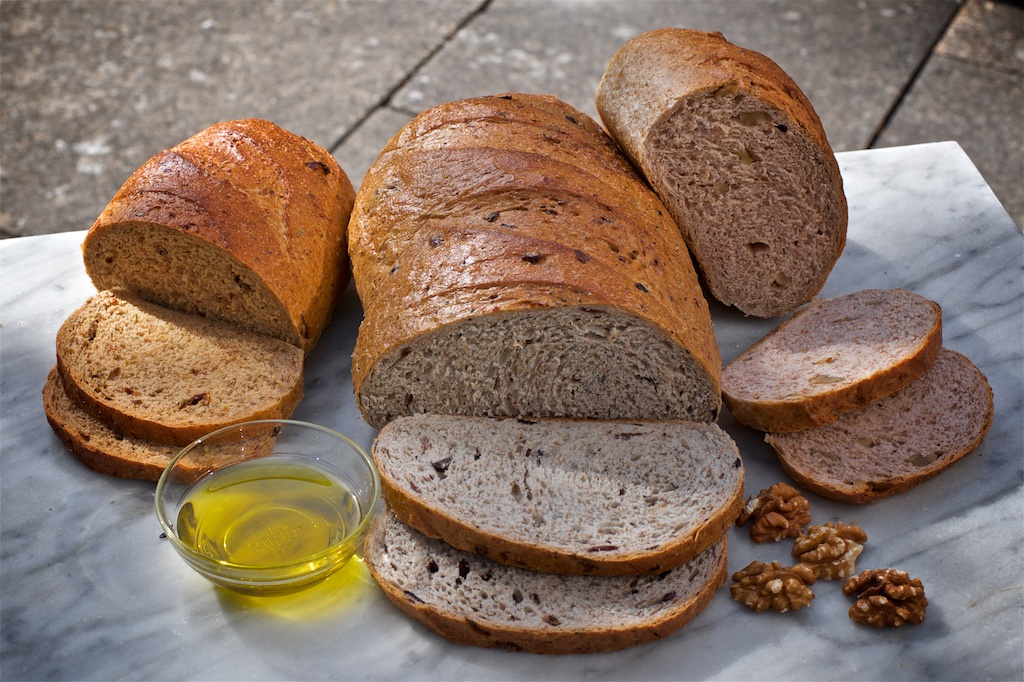 Flavoured Breads - Our walnut, olive and sun-dried tomato breads are fantastic as a mixed bread basket or to serve with cheese.Available as 800g & 400g bloomers