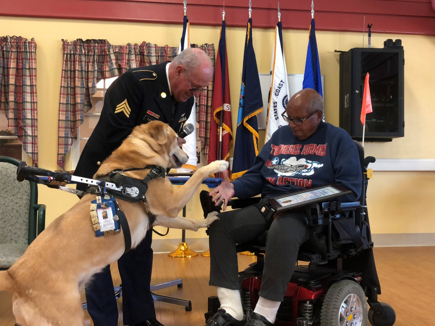 George receives a Certificate of Appreciation from SGT Poitras, and Bliss (the dog is a Silver Star recipient).