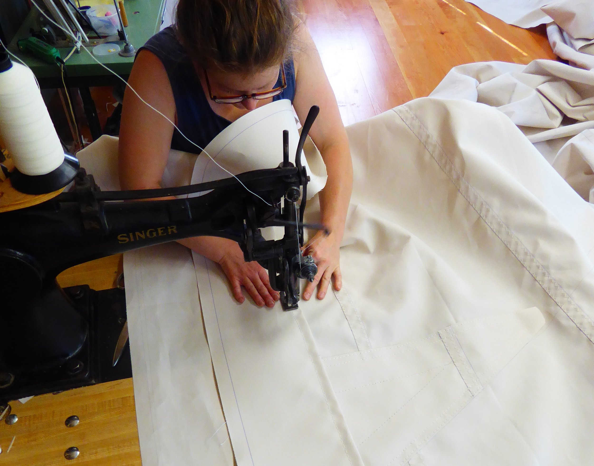 The next step is to sew extra layers in the corners and at the reef clews and tacks.
