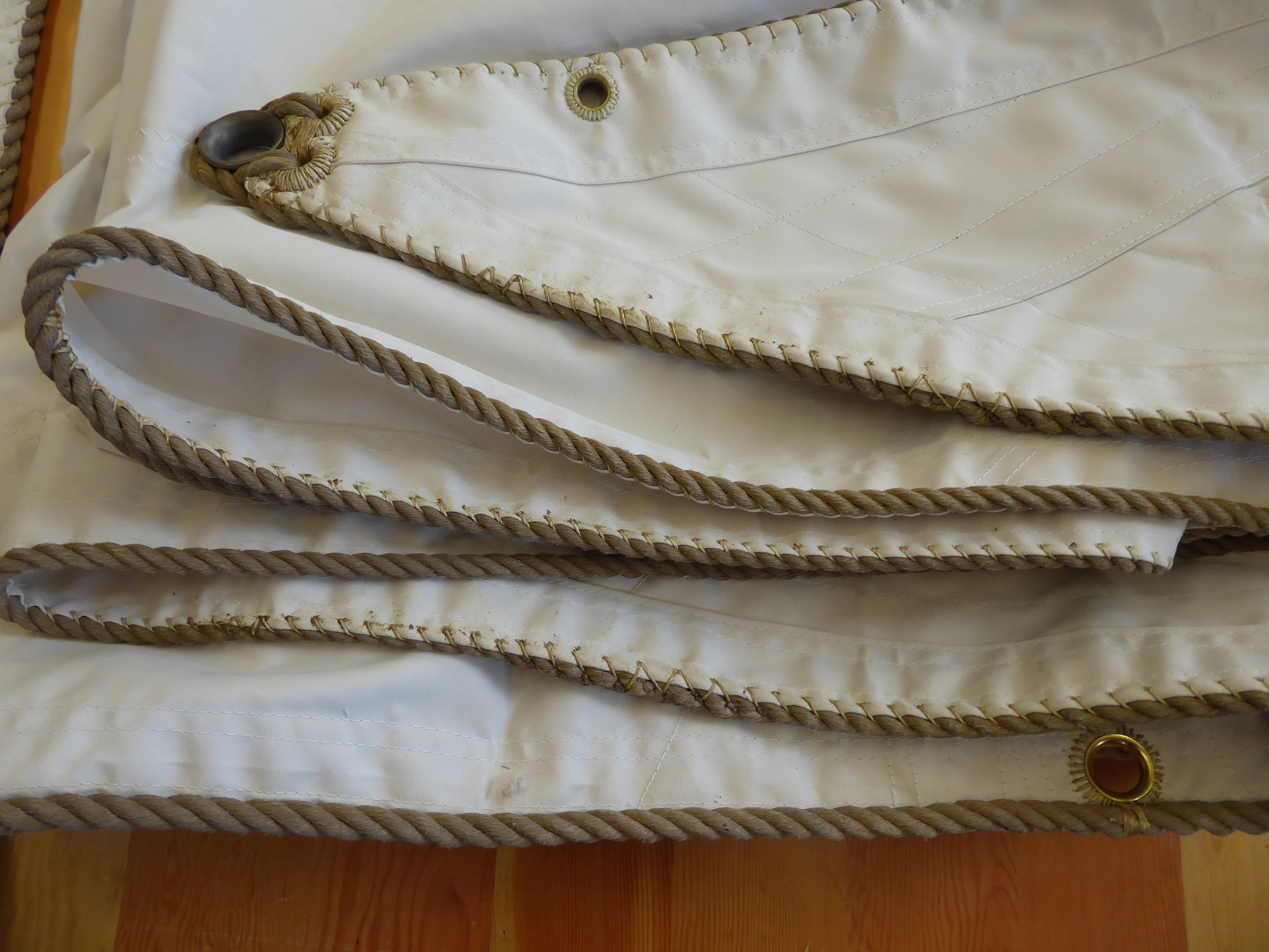 Next we reinforce the edge of the sail by hand sewing rope to all of the edges.