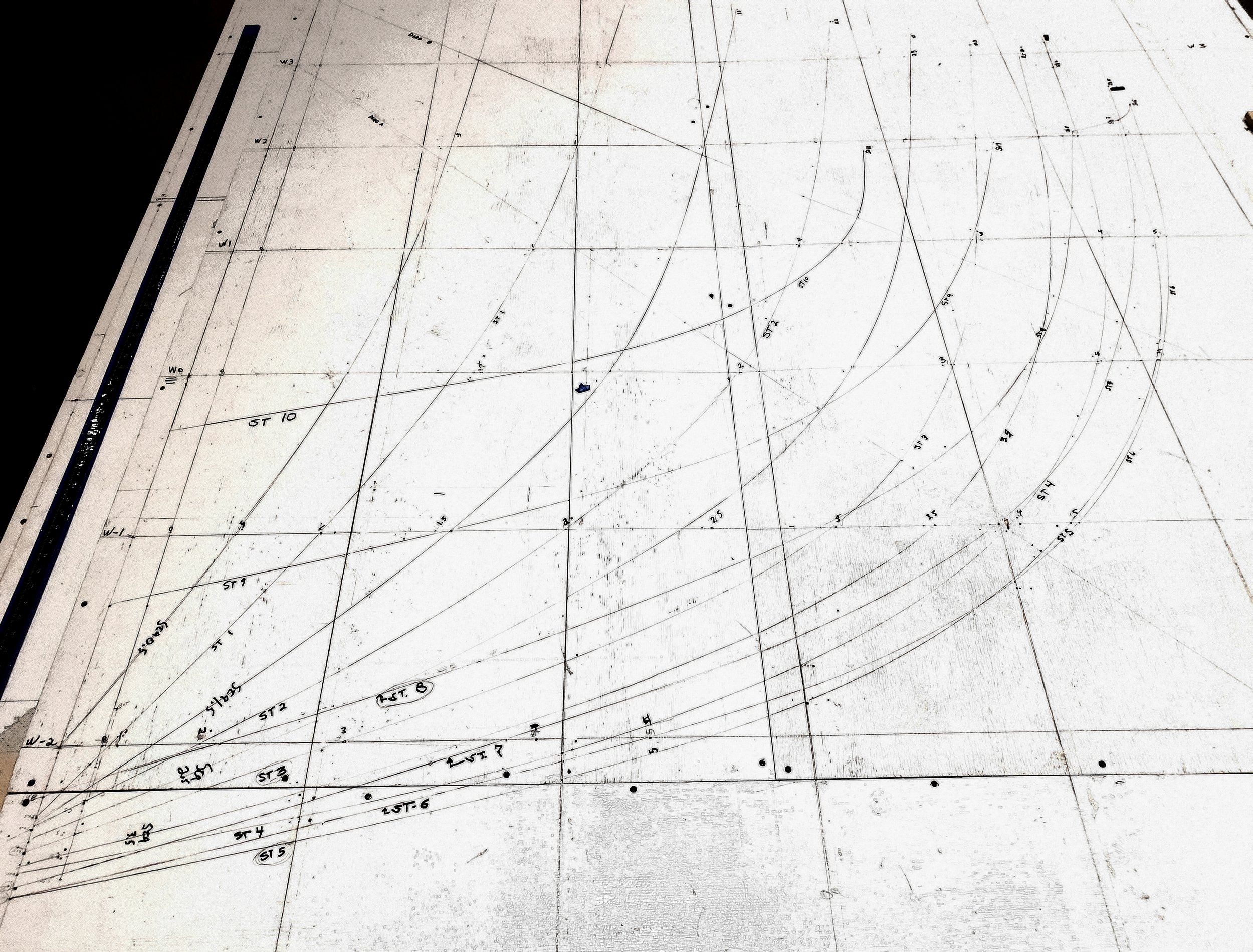 Our waterlines are horizontal with the buttocks running perpendicular and parallel to the center line. Our heights and half-breadths are then plotted where they intersect or land on these lines. A batten, which is a thin, flexible piece of wood or plastic is pushed against awls or nails at these measurements enabling us to create and draw a fair curve.