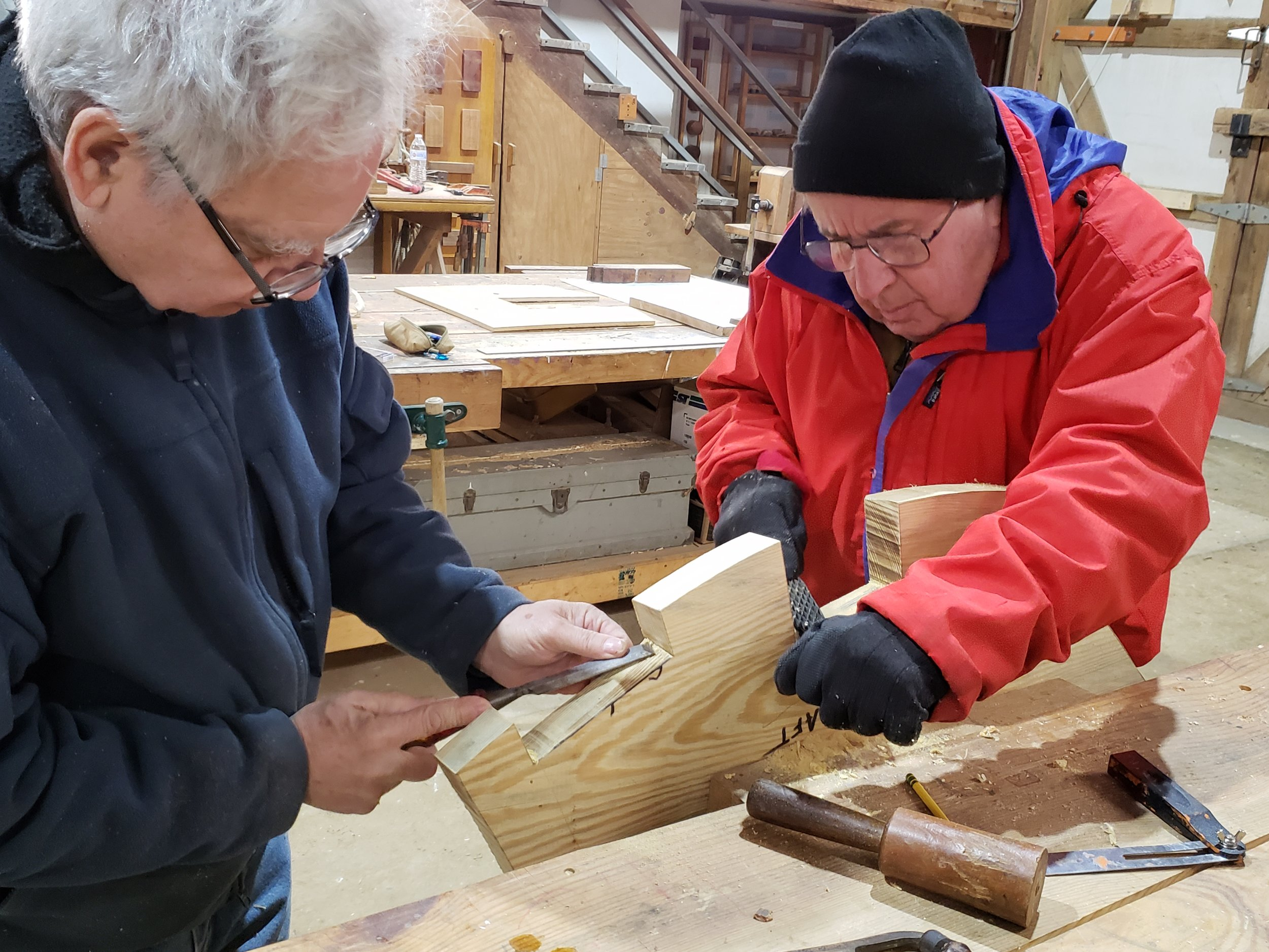Mike and Mario are truing up the bevels on the notched out sections where this mold crosses the stringers.