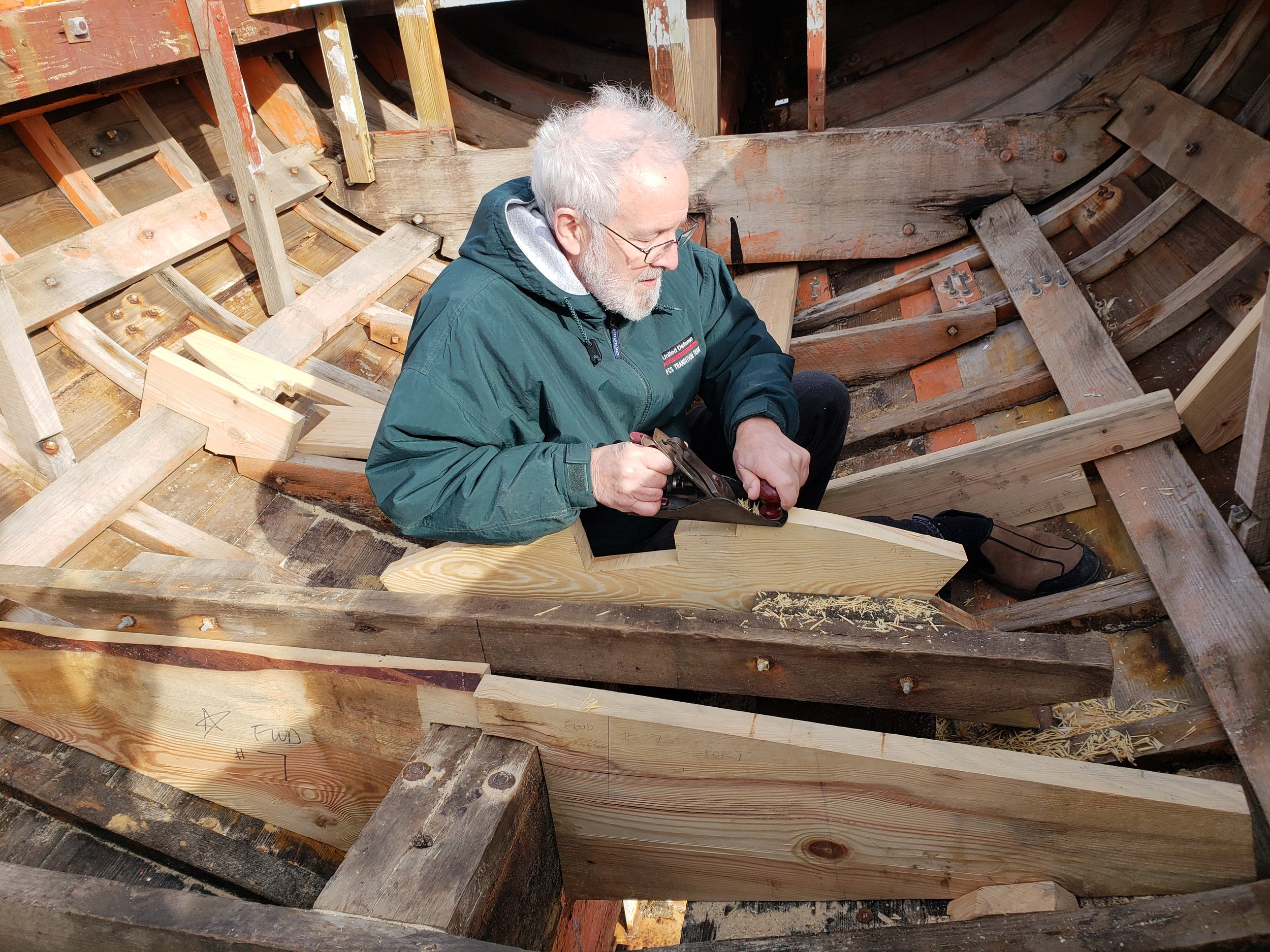George is fine tuning the bevel on station # 7 where it contacts the hull.