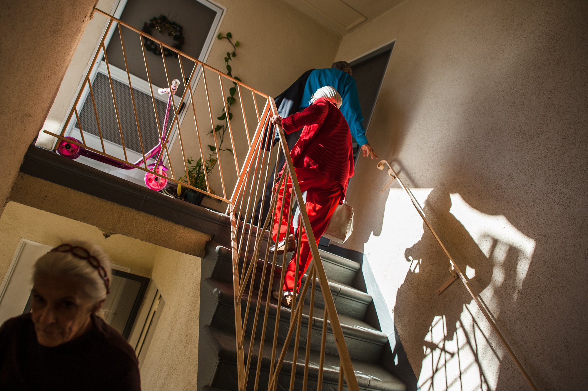 Adina, Will, and Jeanie climb a staircase to visit an apartment where they all may reside together.