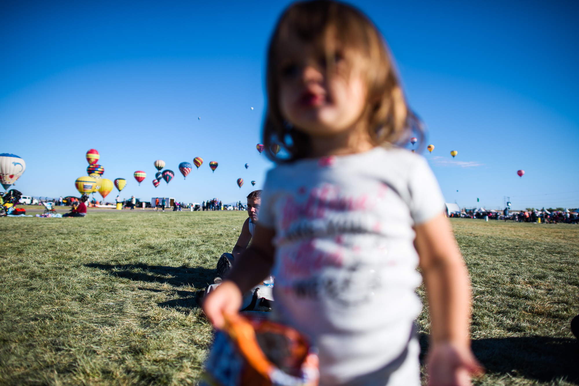 Vinny, age 18, and his daughter Jordyn, age 1, gather at the balloon fiesta in Albuquerque, 2017.