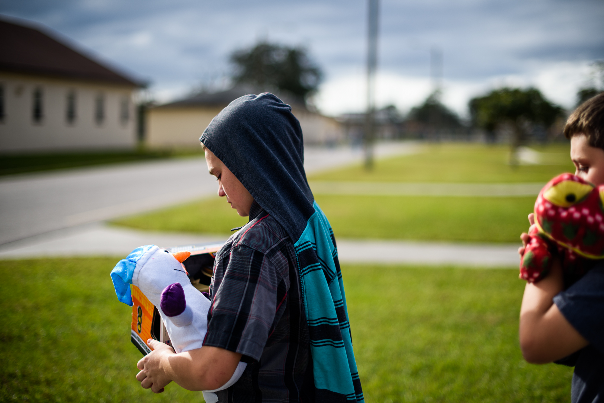 Thomas, age 13, exits the Hernando Correctional Institution in Brooksville, Florida, where his mom, Opal, is incarcerated; Thomas has not seen Opal since she was arrested 4 years prior.