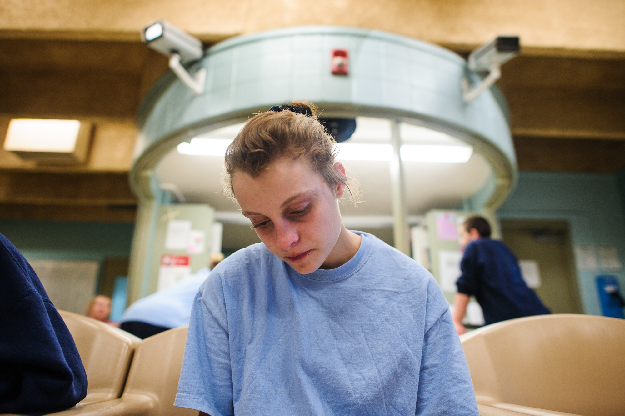 Alysia, age 16, sits in the communal area and draws in the girls' unit at the juvenile detention center.