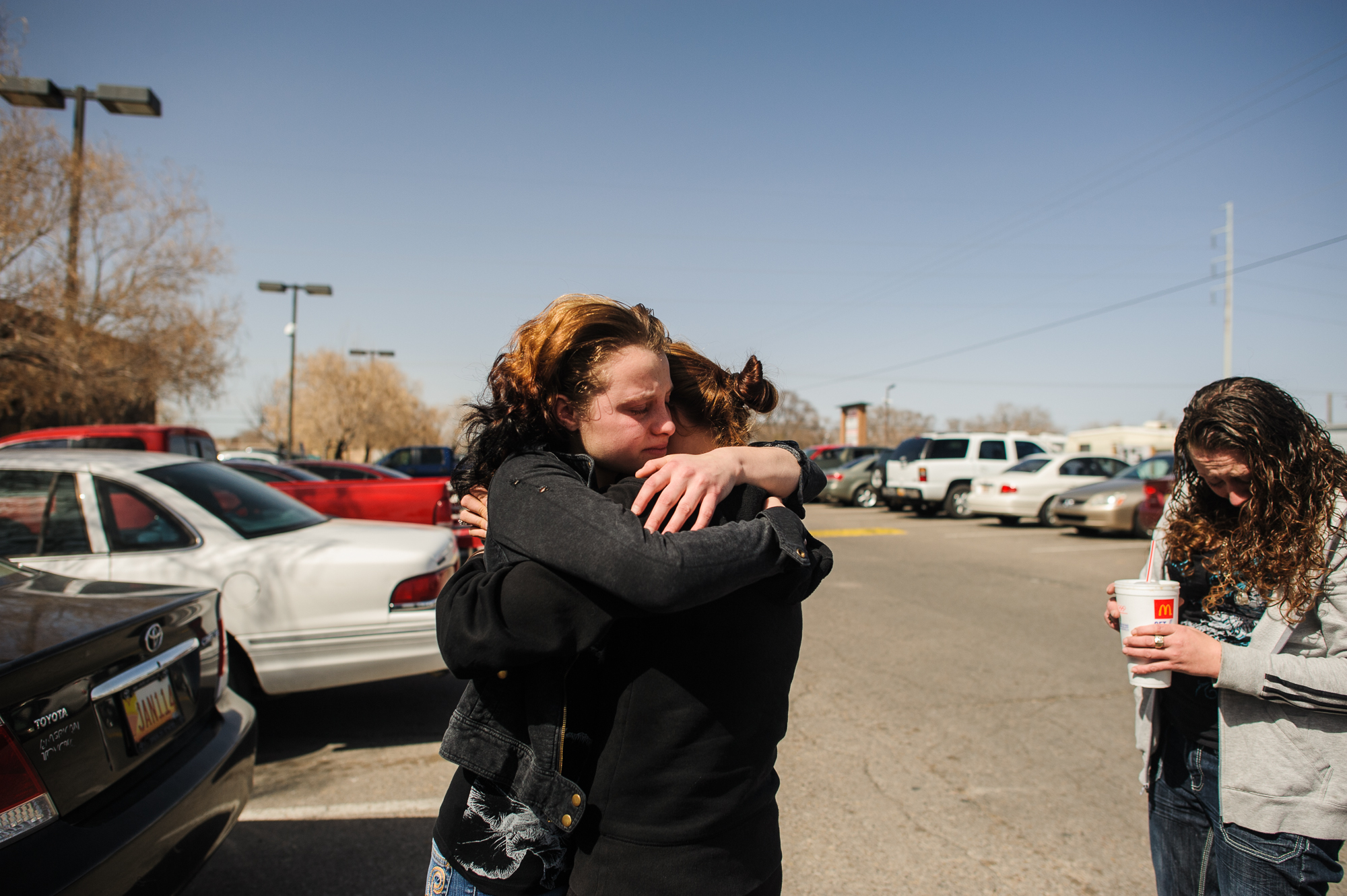 Alysia cries and hugs her cousin, while her mother, Anastasia, (right) stands and cries. Alysia is given 10 minutes to hug her cousin and her mother before being transferred to a court-ordered treatment facility for 6 months where she will focus on getting sober from meth.