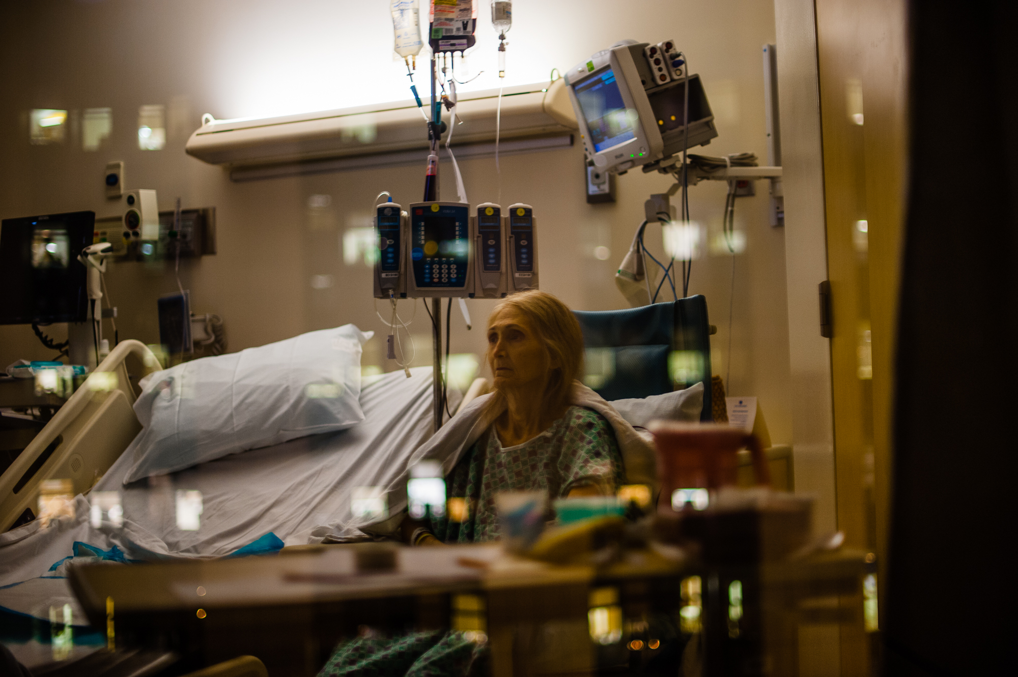 Rosie sits in a hospital room in Los Angeles at night.
