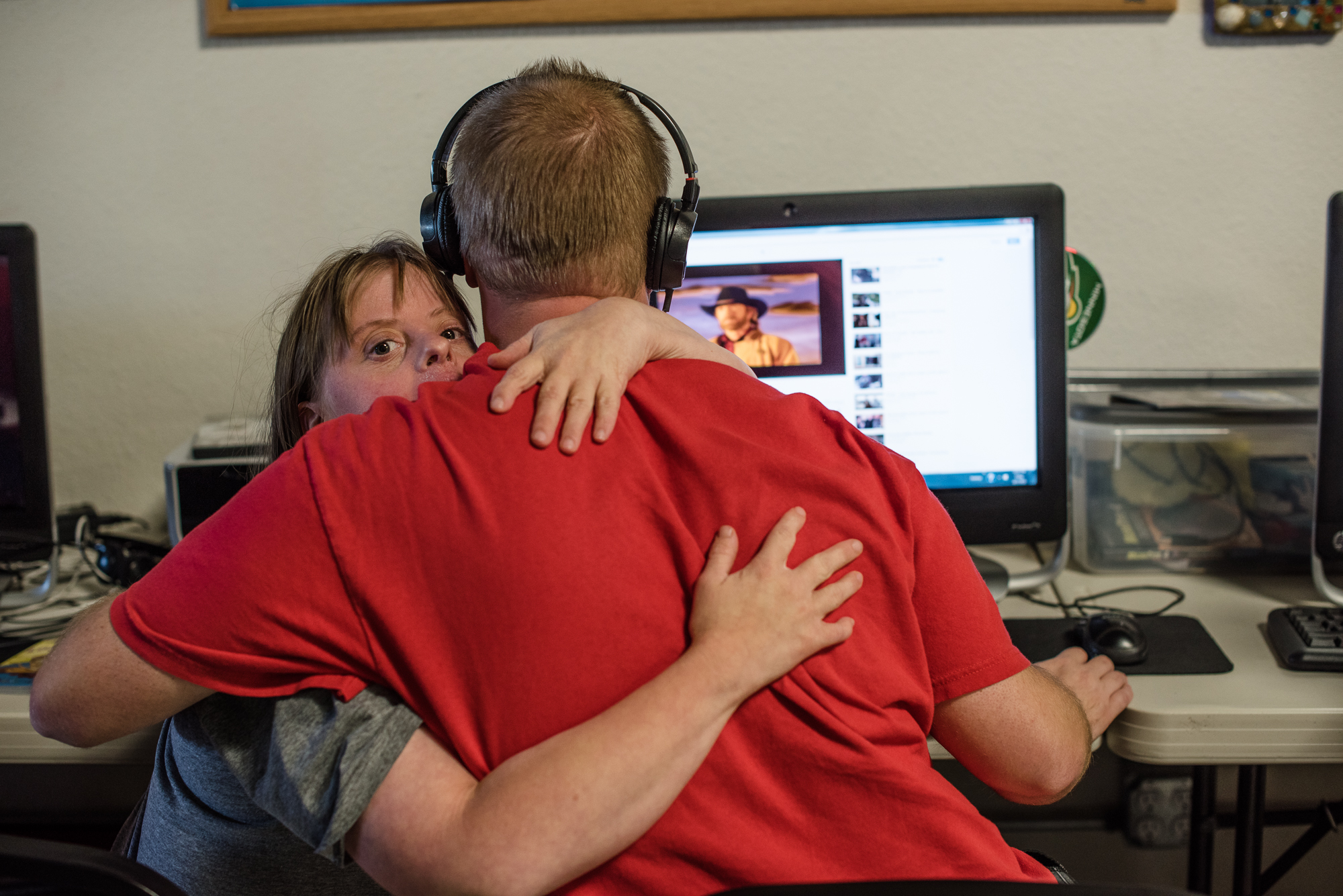 Krysta holds Nathaniel, as he watches a video during the workshop they attend daily.