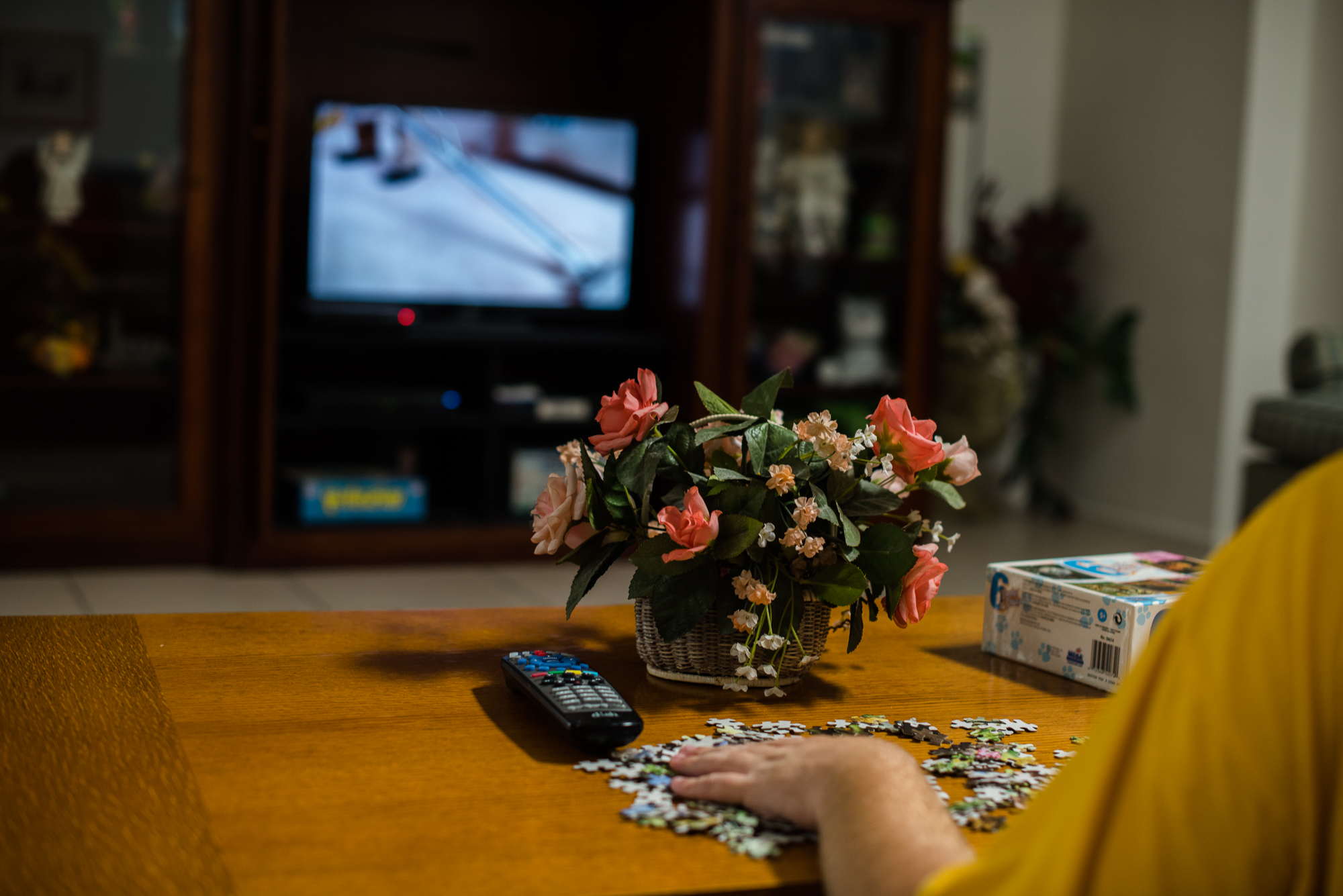 Nathaniel does a puzzle in front of the television inside the group home where Krysta lives.