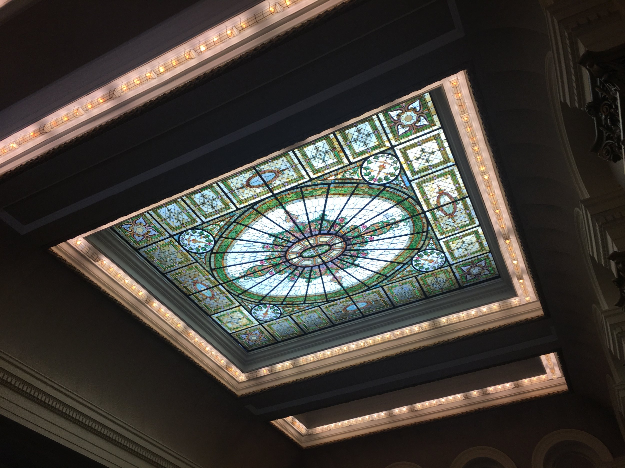The multicolored stained glass skylight in the main courtroom on the third floor of the Queens County Courthouse in Long Island City. //  Eagle  photo by Clarissa Sosin