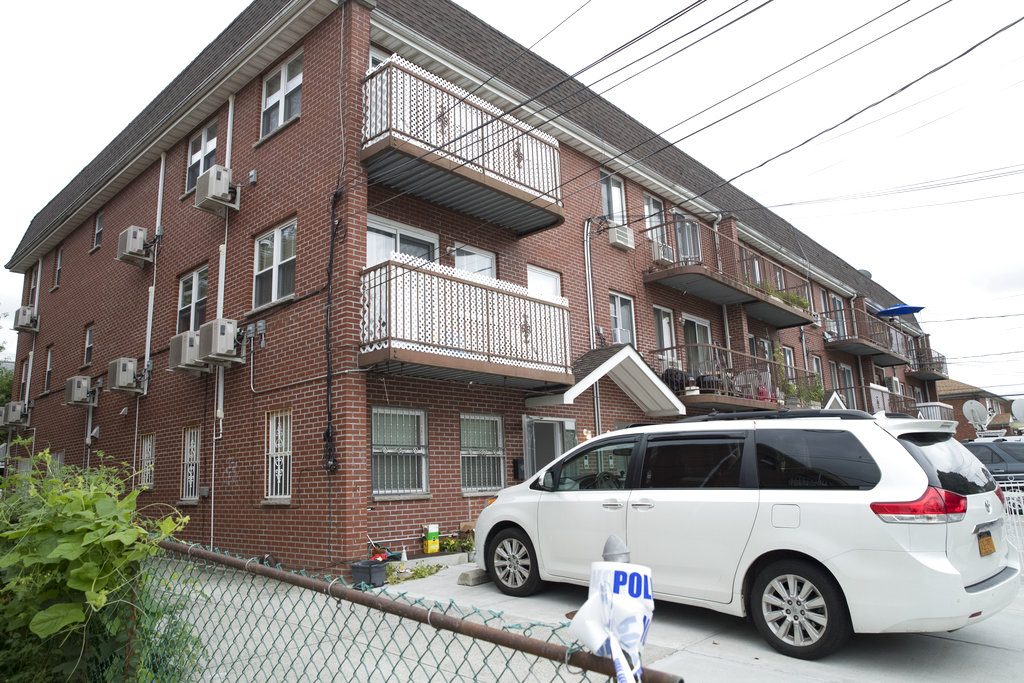 The Flushing home where five people were stabbed in the early morning hours last Friday. // AP Photo by Mary Altaffer