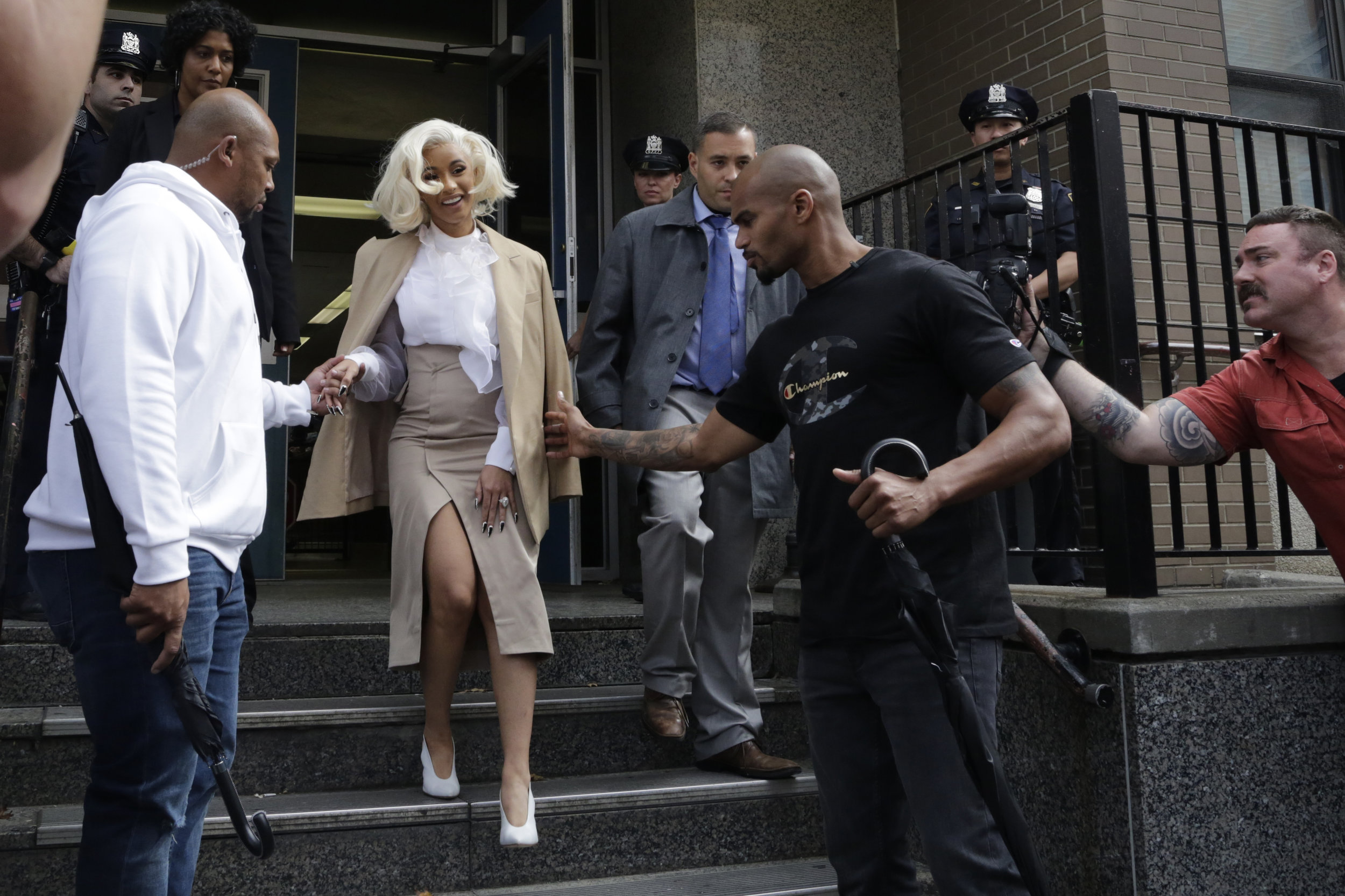 Cardi B leaves a Flushing police precinct after being charged with reckless endangerment. She will appear in Queens Criminal Court on Oct. 29. AP Photo.