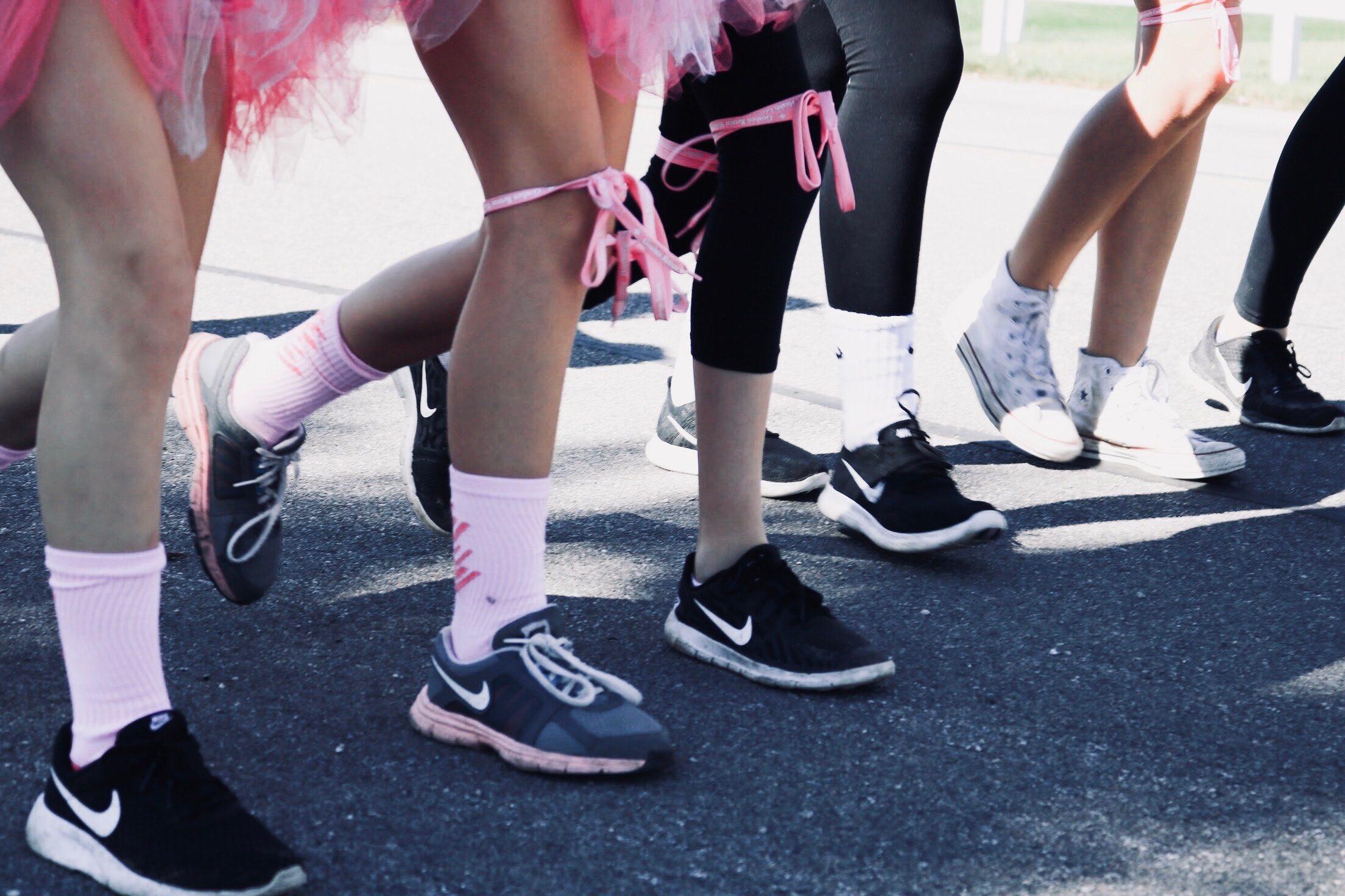 Unidentified runners participating in a run or walk. Photo by  sydney Rae  on  Unsplash .