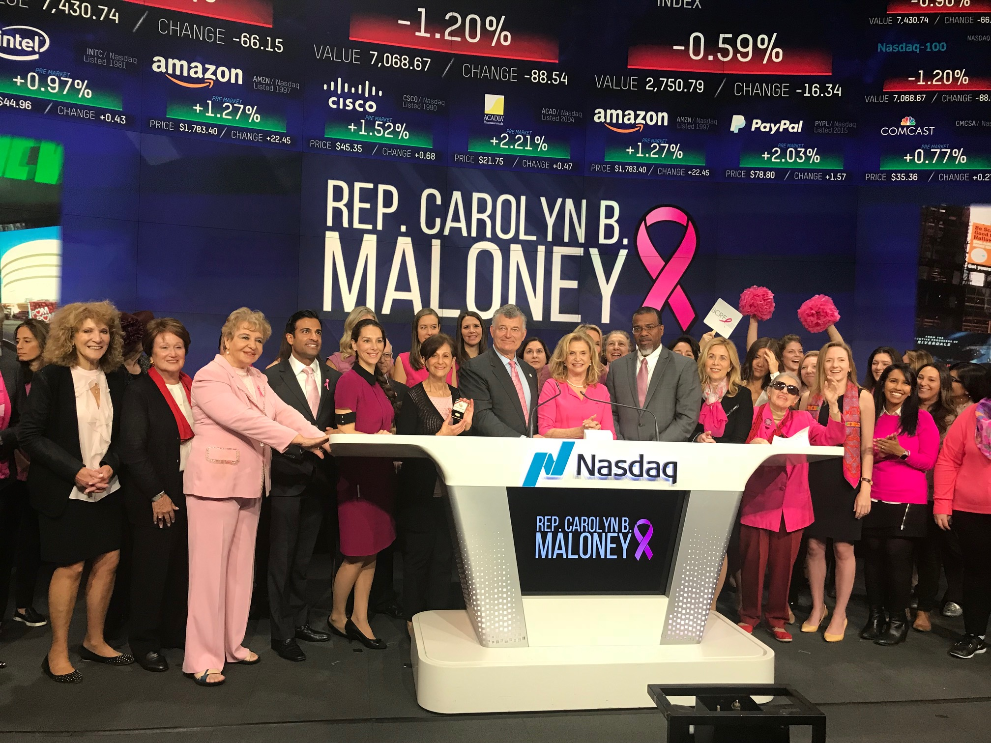 Caption: Carolyn B. Maloney rang the opening bell at NASDAQ to bring awareness to and help support breast cancer research.