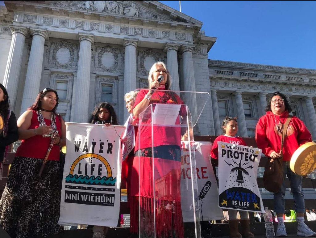 Photo credit: Pennie Opal Plant speaking at the Women's March, San Francisco 2018. Photo Credit: Natasha Singer.