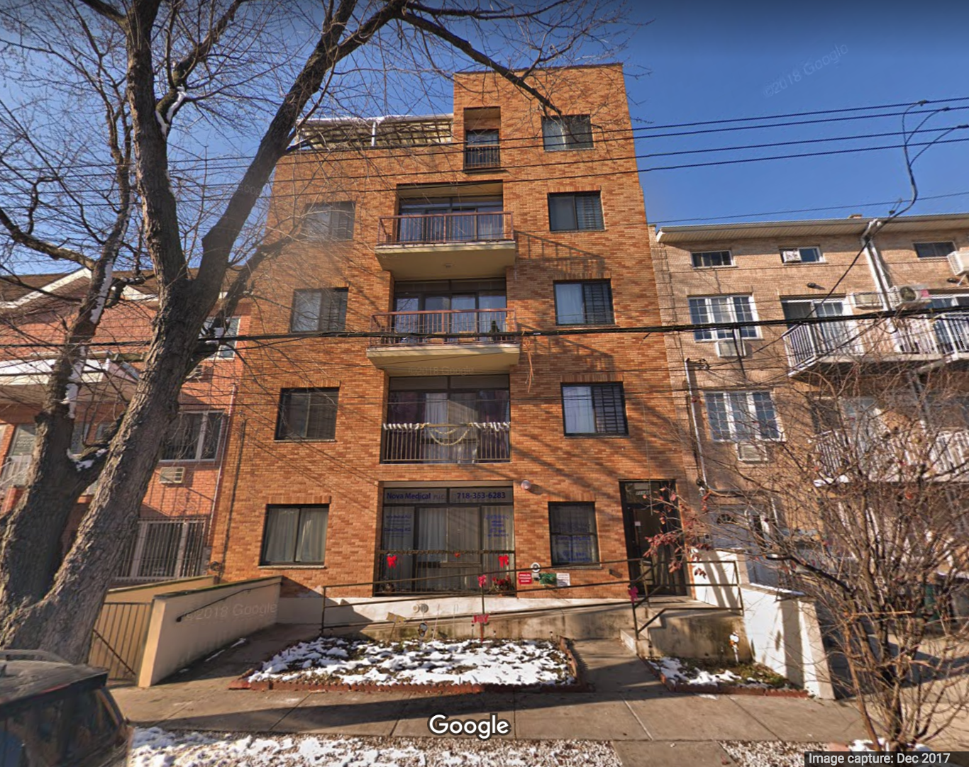Two property owners allegedly failed to pay taxes on a building located at 71-44 160th Street in Fresh Meadows. Google Maps photo.