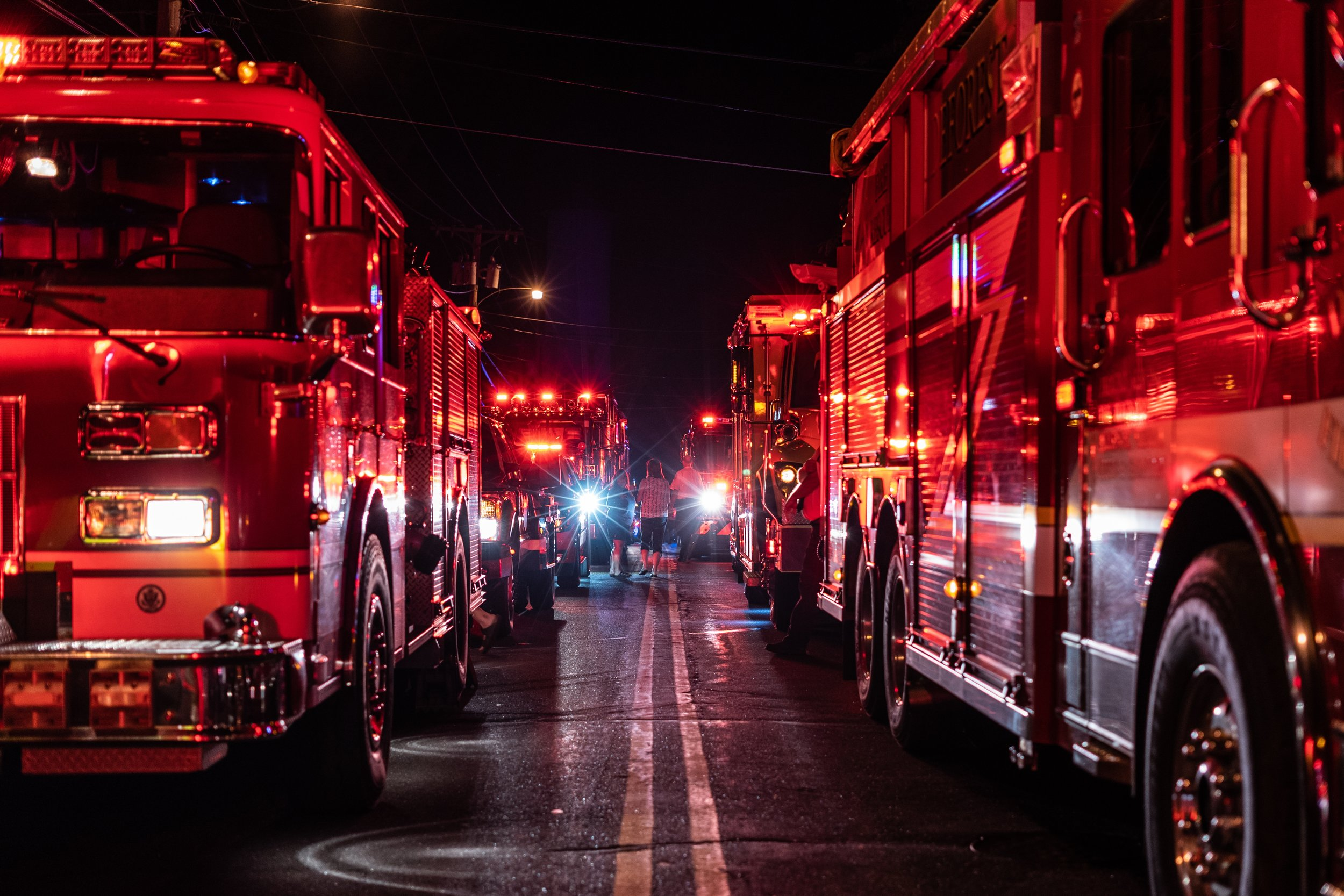 Firetrucks. Photo by Connor Betts courtesy of Unsplash