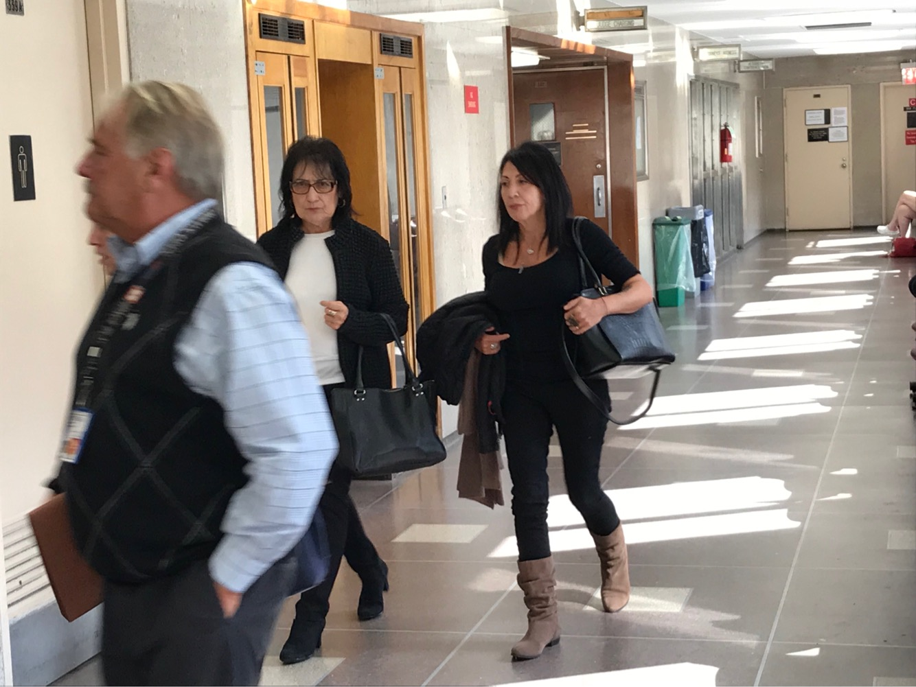 Karina Vetrano's mother walks down the hallway in Queens Criminal Court during the first day of jury selection Monday.  Eagle  photos by David Brand.