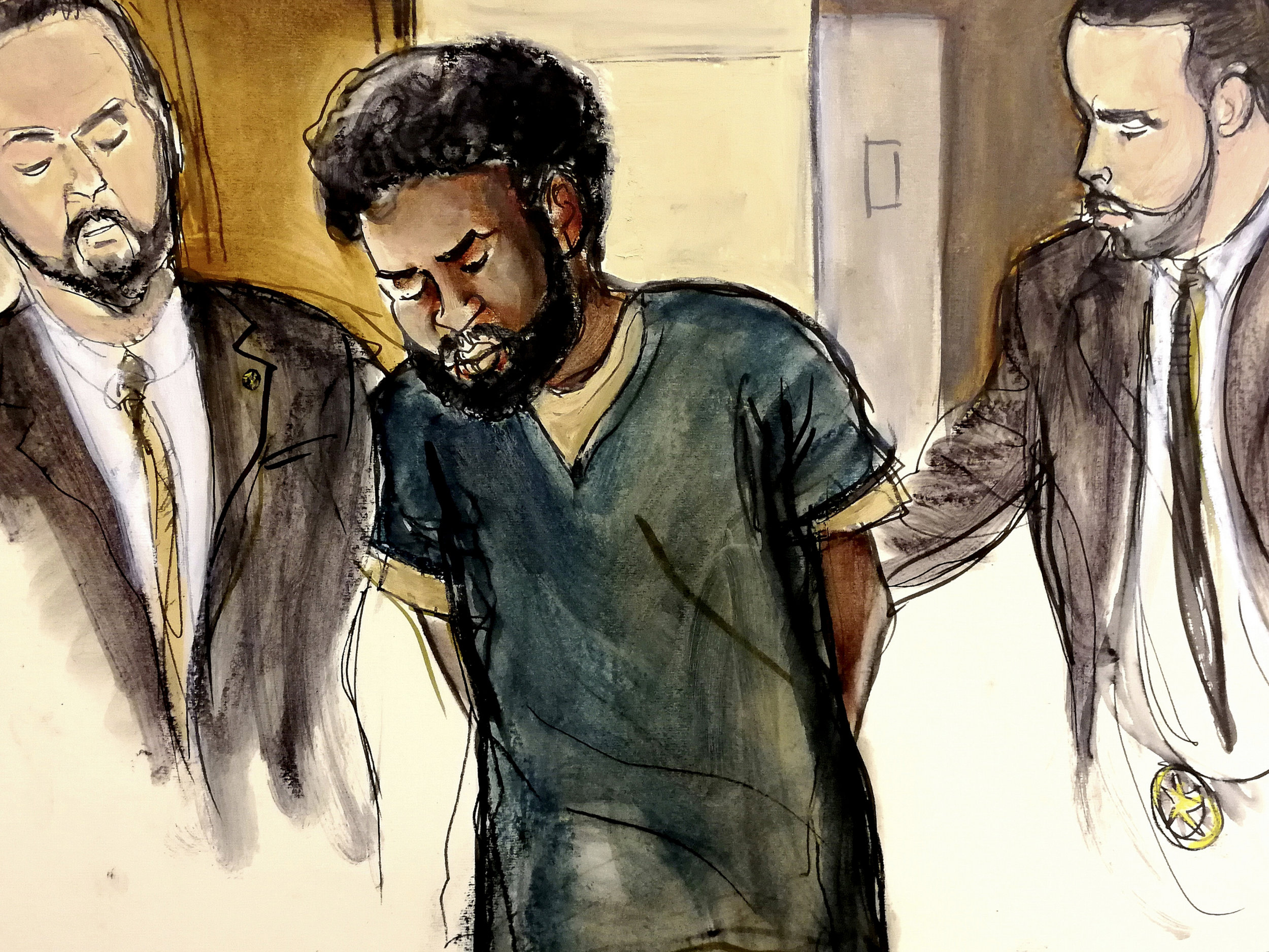 In this Jan. 11, 2018 courtroom drawing, U.S. Marshals escort Akayed Ullah, center, into court in Manhattan for his arraignment on charges of setting off a pipe bomb in a Manhattan subway corridor at Time Square. Image by Elizabeth Williams via AP File.