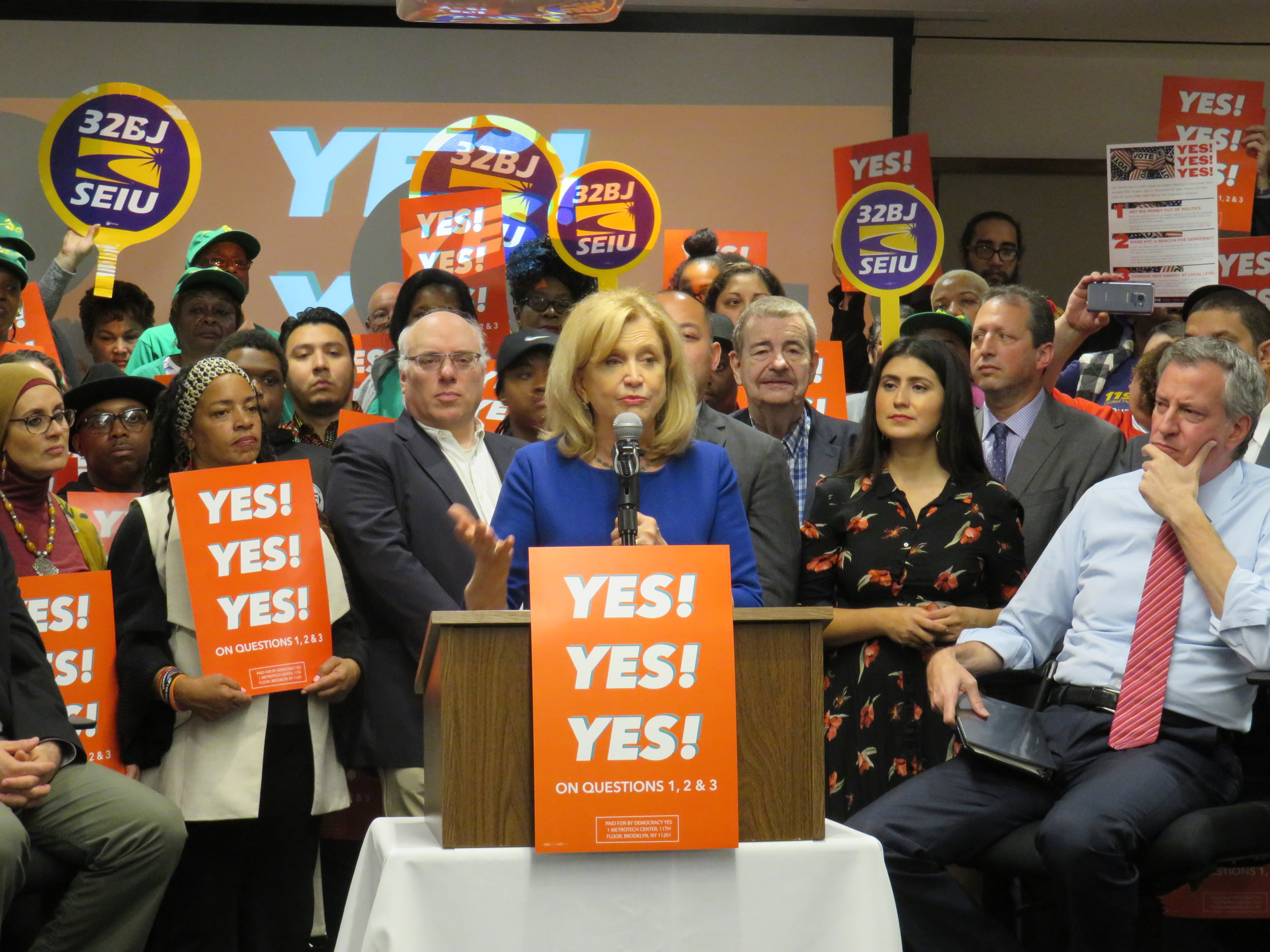 U.S. Rep. Carolyn Maloney, who represents Western Queens, urged voters to support three charter revision ballot proposals at a rally last Thursday. All three ballot proposals passed overwhelmingly.  Eagle  photo by David Brand.