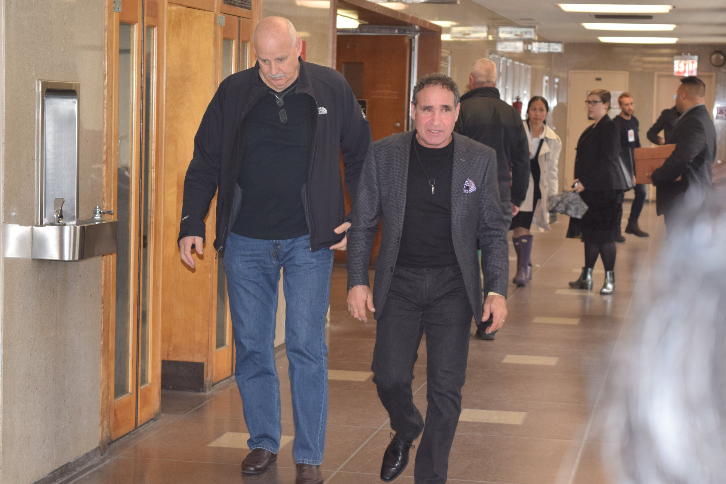 Karina Vetrano's father Phil Vetrano walks down the hall in Queens Criminal Court Tuesday. //  Eagle  photo by Christina Carrega