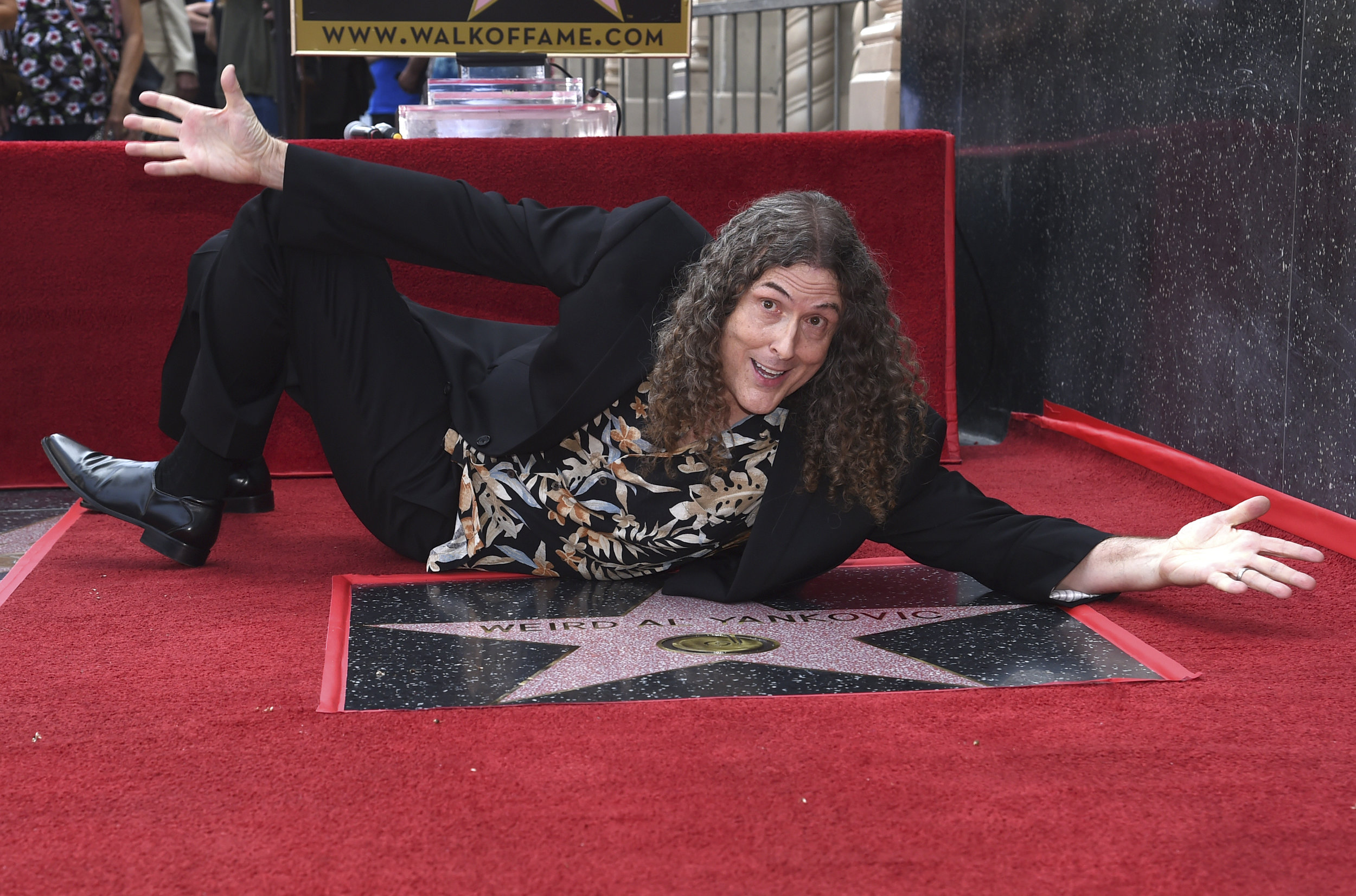 Musician and comedian Weird Al Yankovic is performing with the Queens Symphony Orchestra this summer at Forest Hills Stadium. AP Photo by Richard Shotwell.
