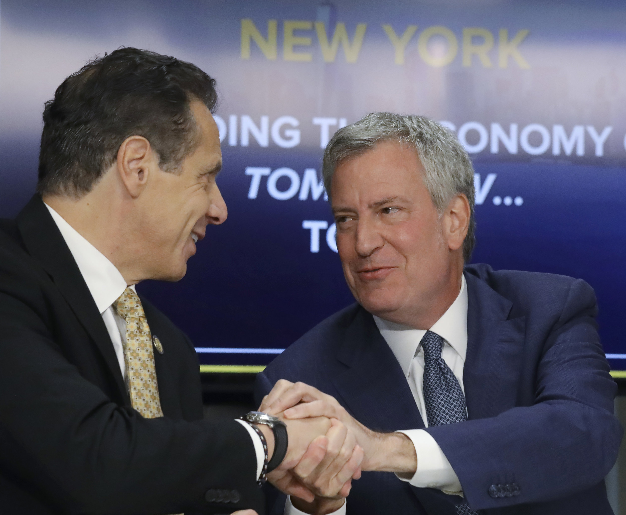 Gov. Andrew Cuomo and Mayor Bill de Blasio both embraced Amazon's arrival at a press conference this week. AP Photo.