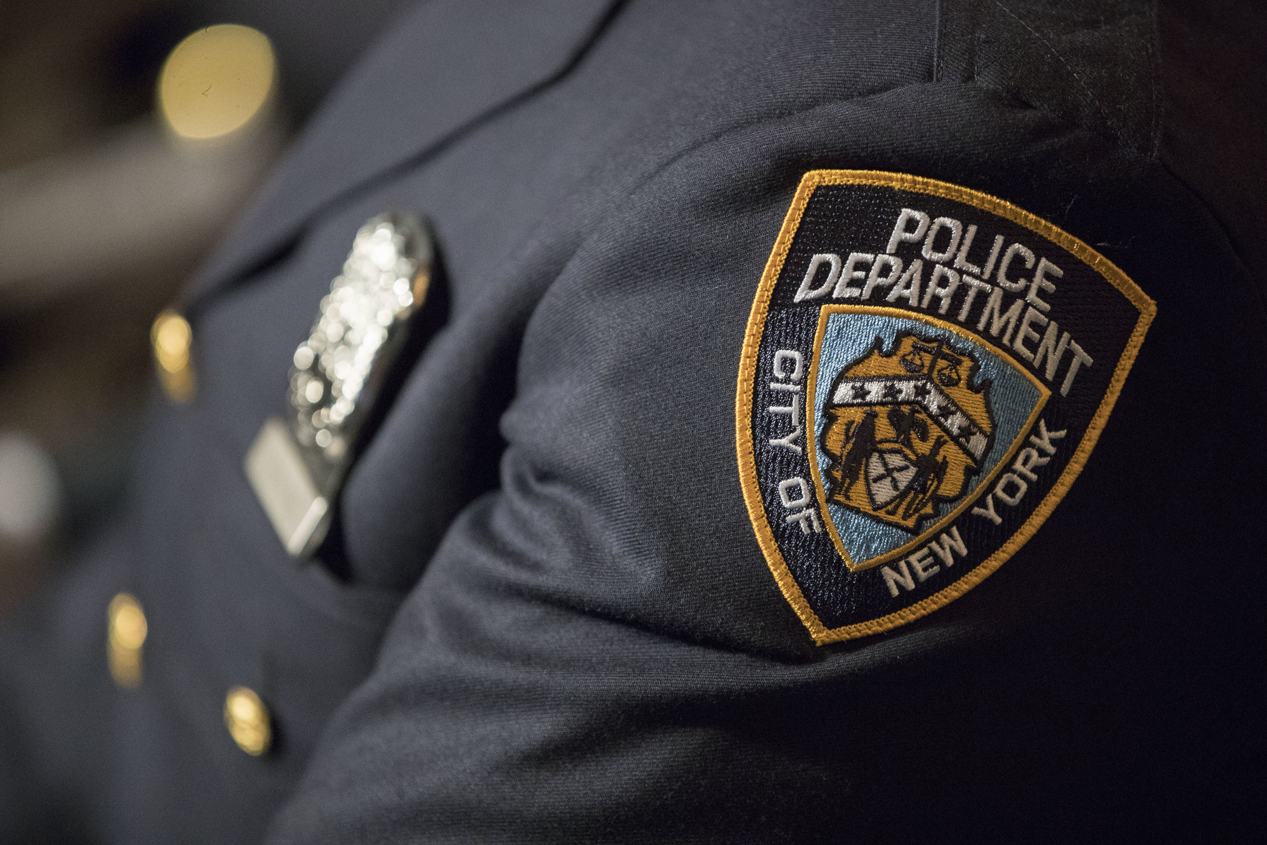 A detail including the badge and shield of one of the newest members of the New York City police is seen during his graduation ceremony, Thursday, June 29, 2017, in New York. AP Photo by Mary Altaffer.