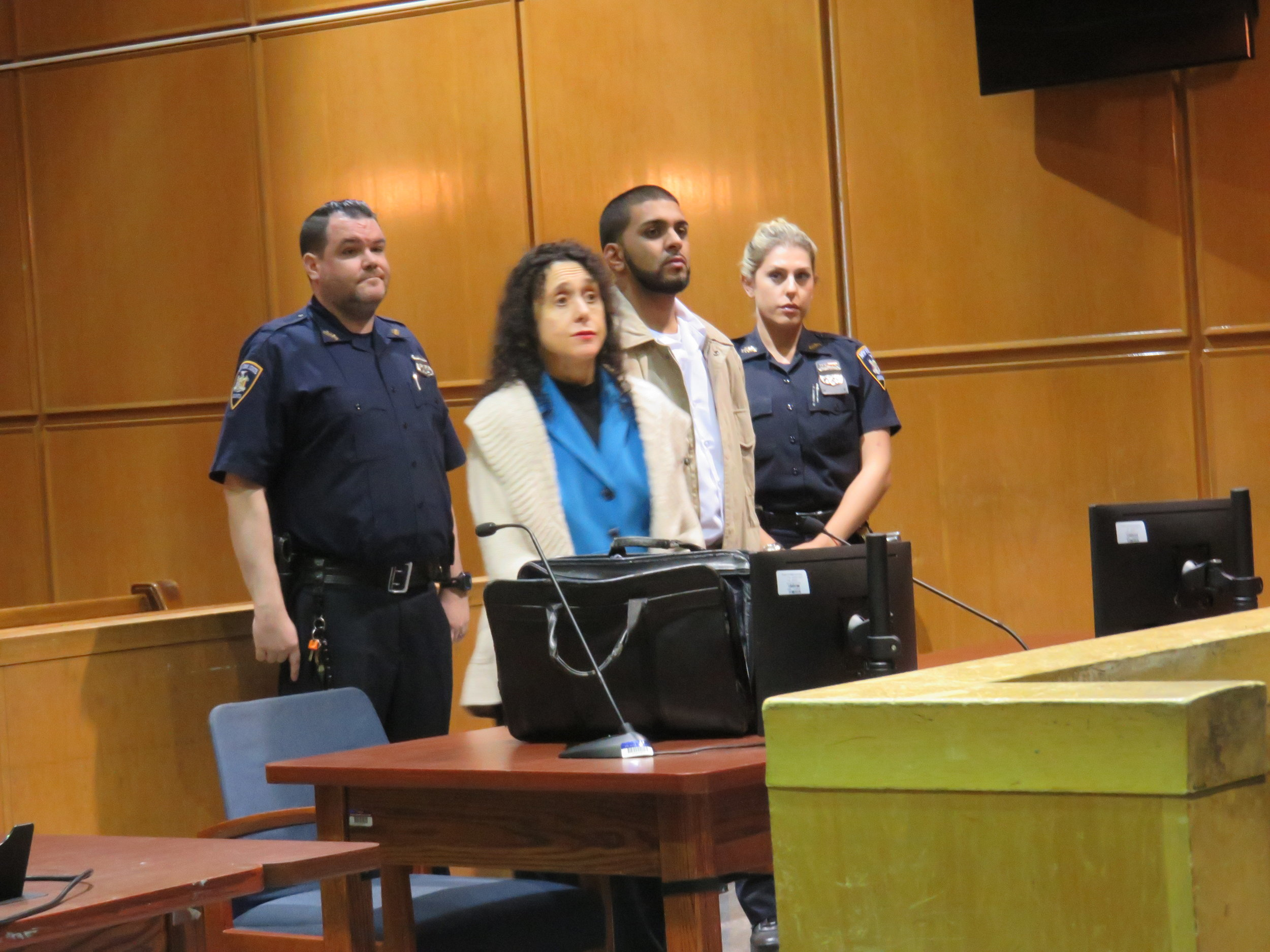 Muhammad Ali (second from right) is accused of crashing his car into a police officer and crushing his leg appeared in Queens Criminal Court Monday.  Eagle  photo by David Brand.