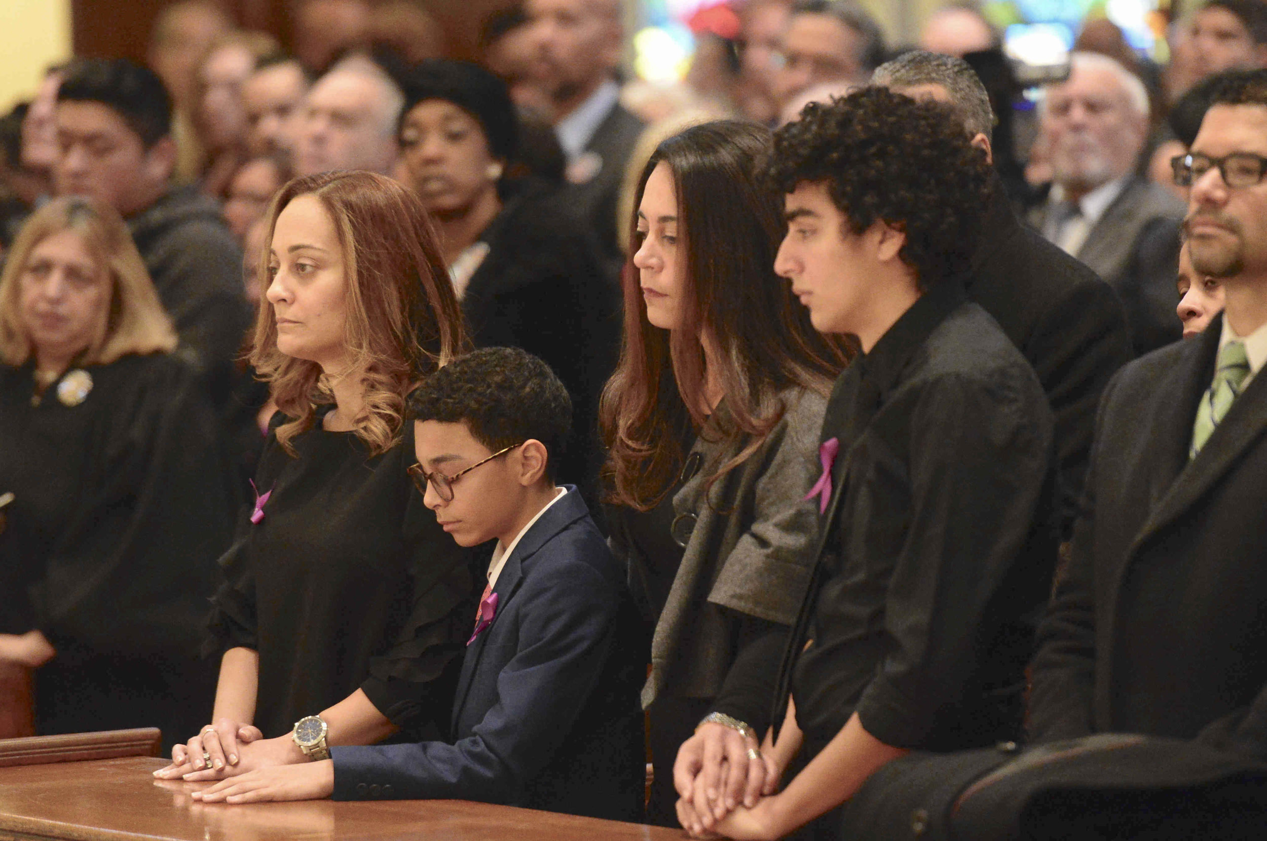 Family members mourn Peralta. //  Eagle  photo by Todd Maisel